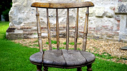 Brown Wooden Chair on Green Grass