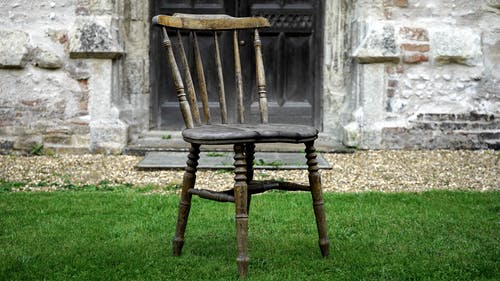 Brown Wooden Chair on Grass