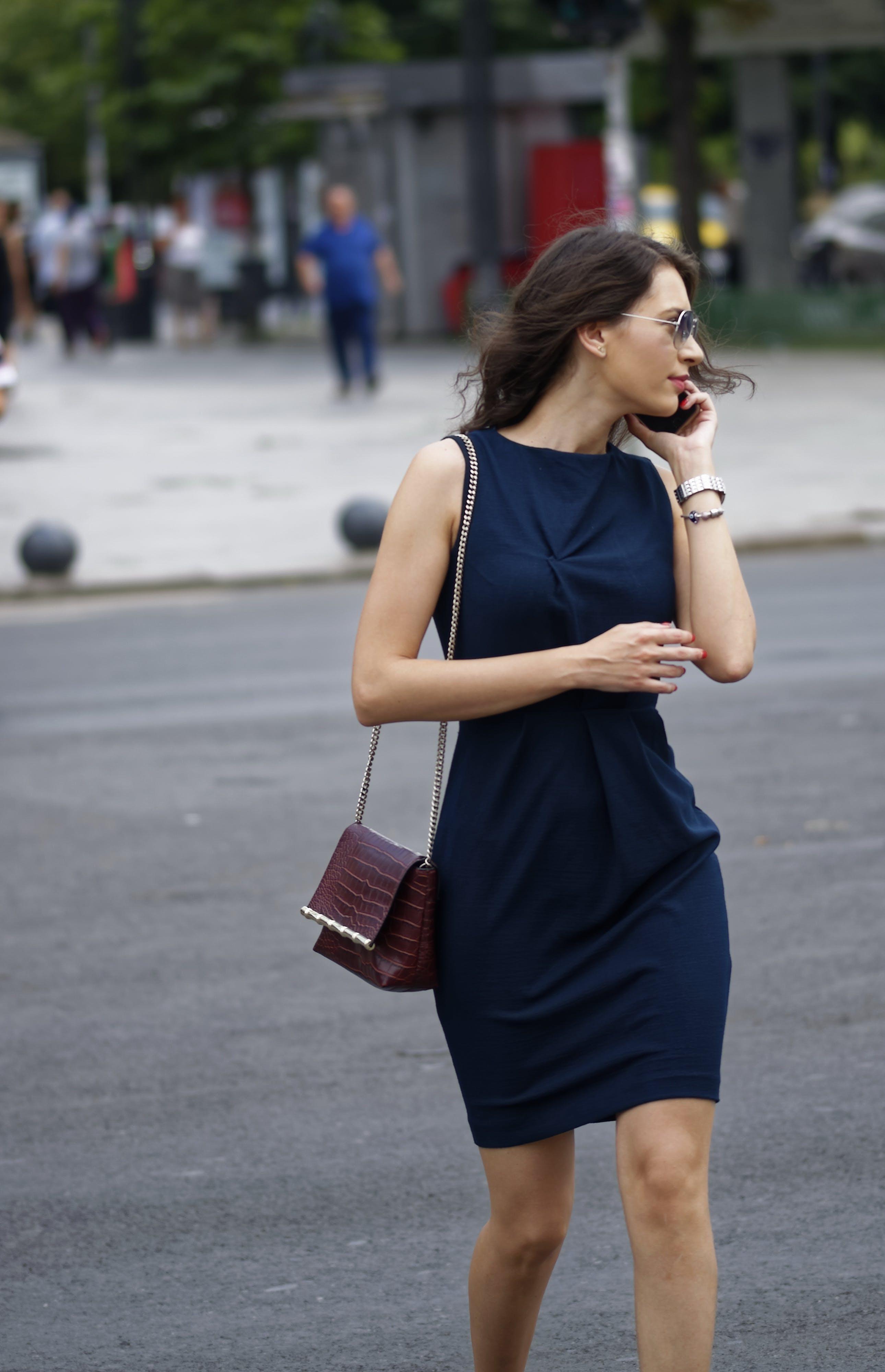 Woman Wearing Black Sleeveless Bodycon Mini Dress