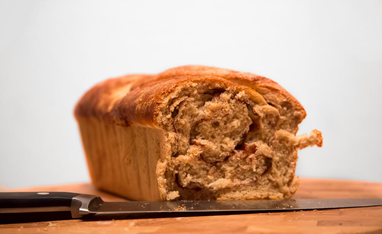 Loaf Bread on Brown Wooden Tabletop