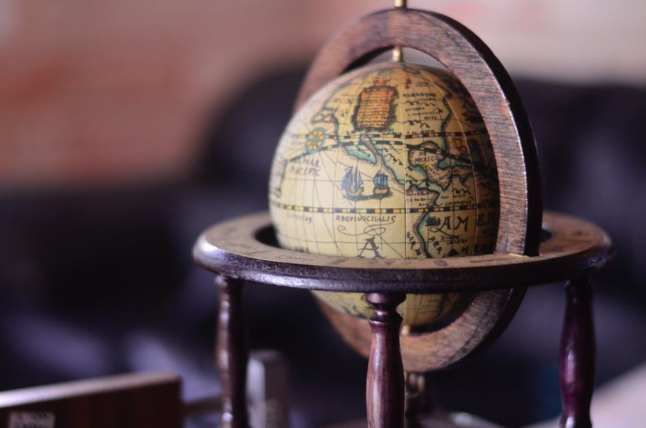 Shallow focus photography of brown globe