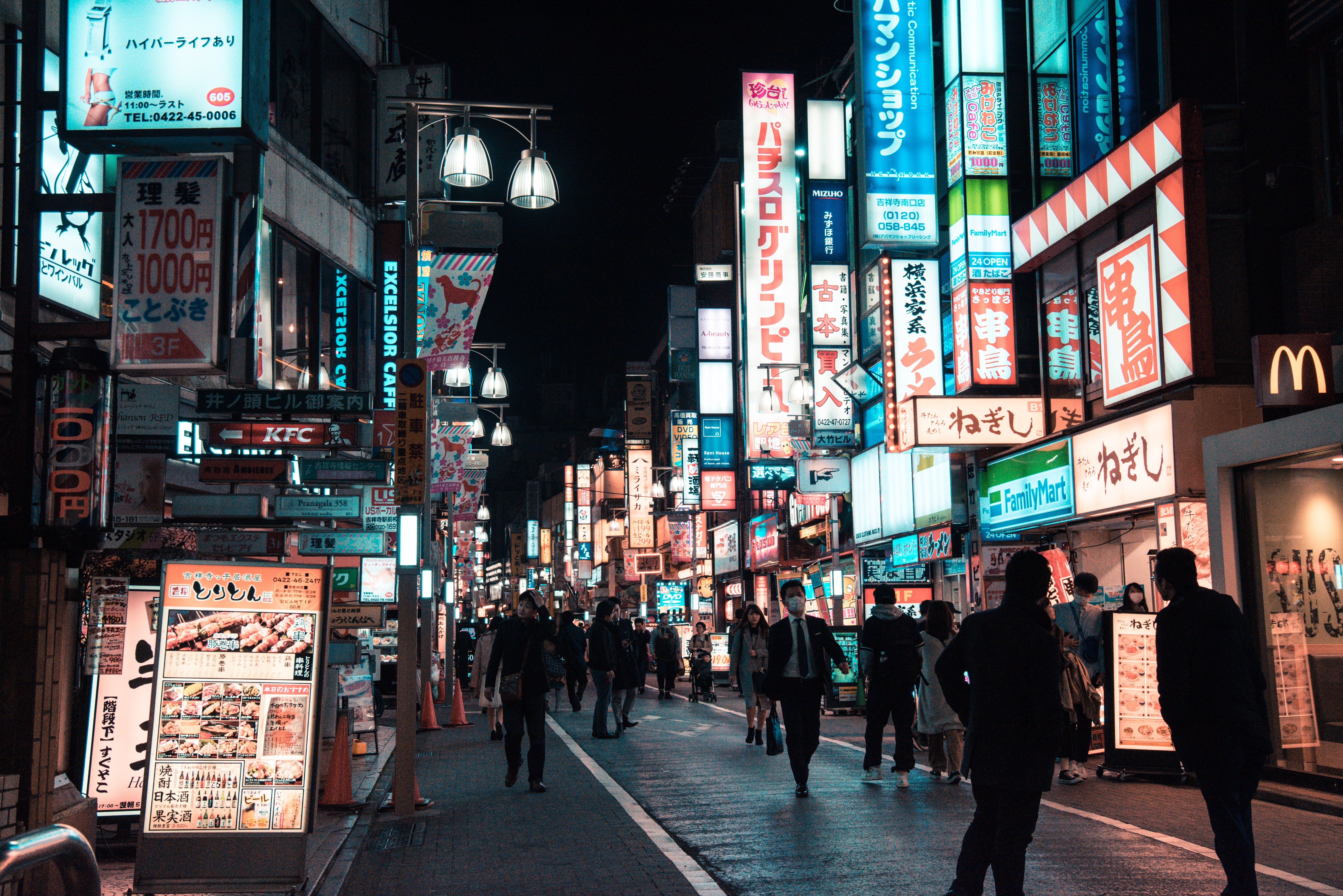 Street With People Walking during Night