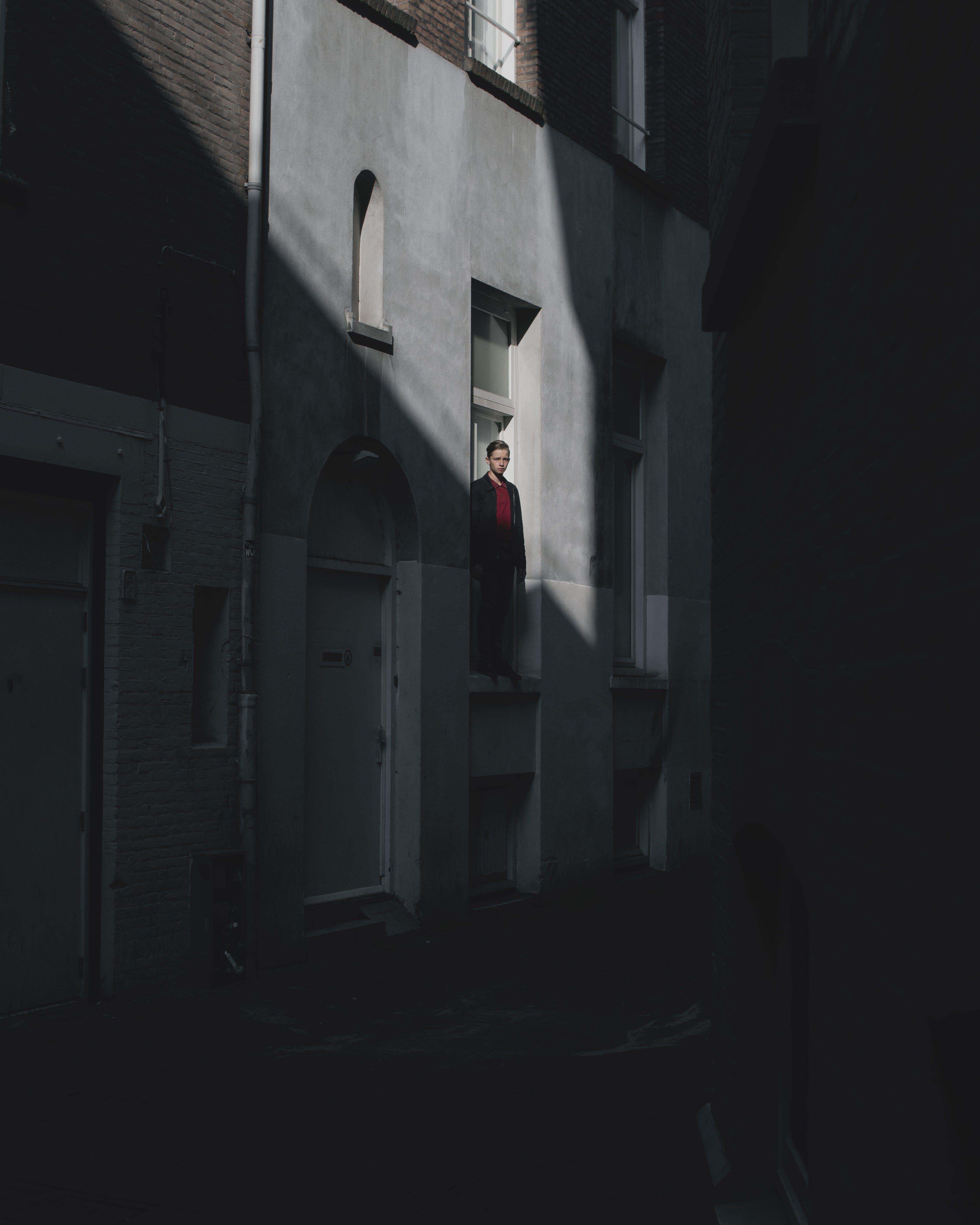 Man Standing on Window