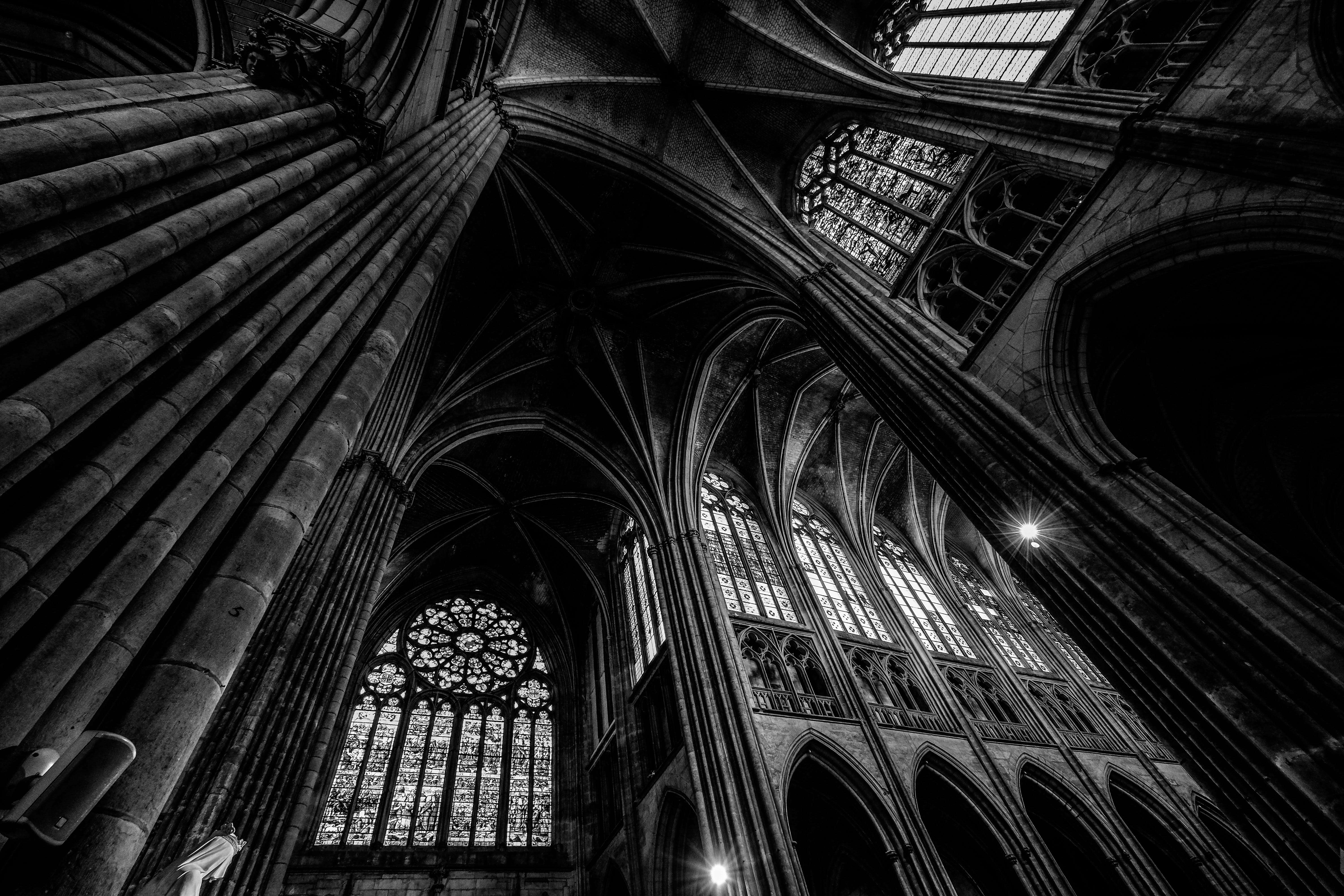 Grayscale Photography of Cathedral Ceiling
