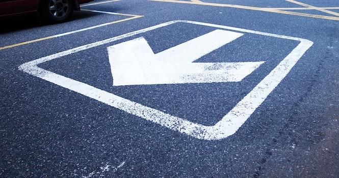White Road Arrow Sign