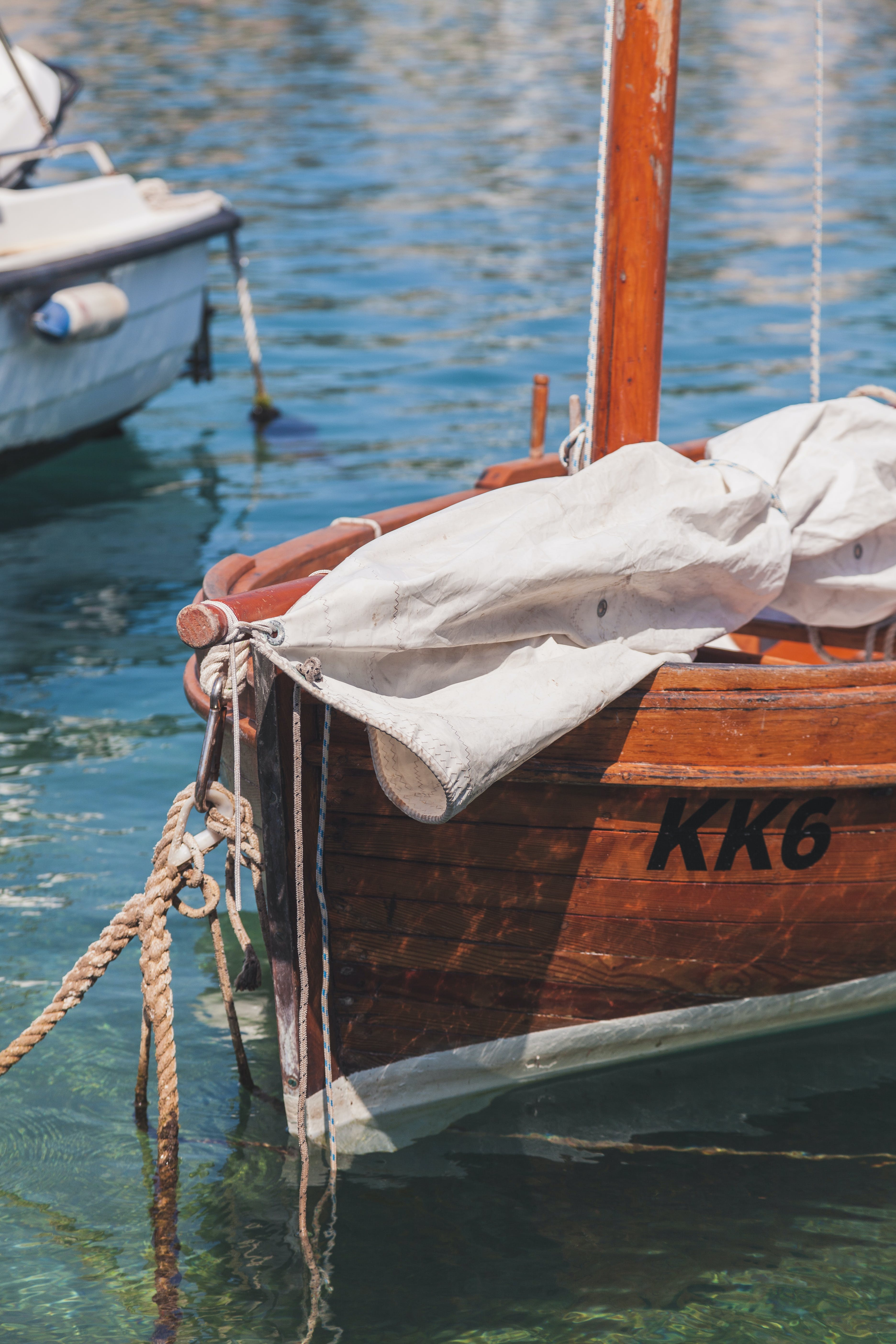 White Textile on Brown Boat