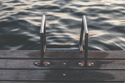 Gray Steel Dock Ladder Beside Body of Water