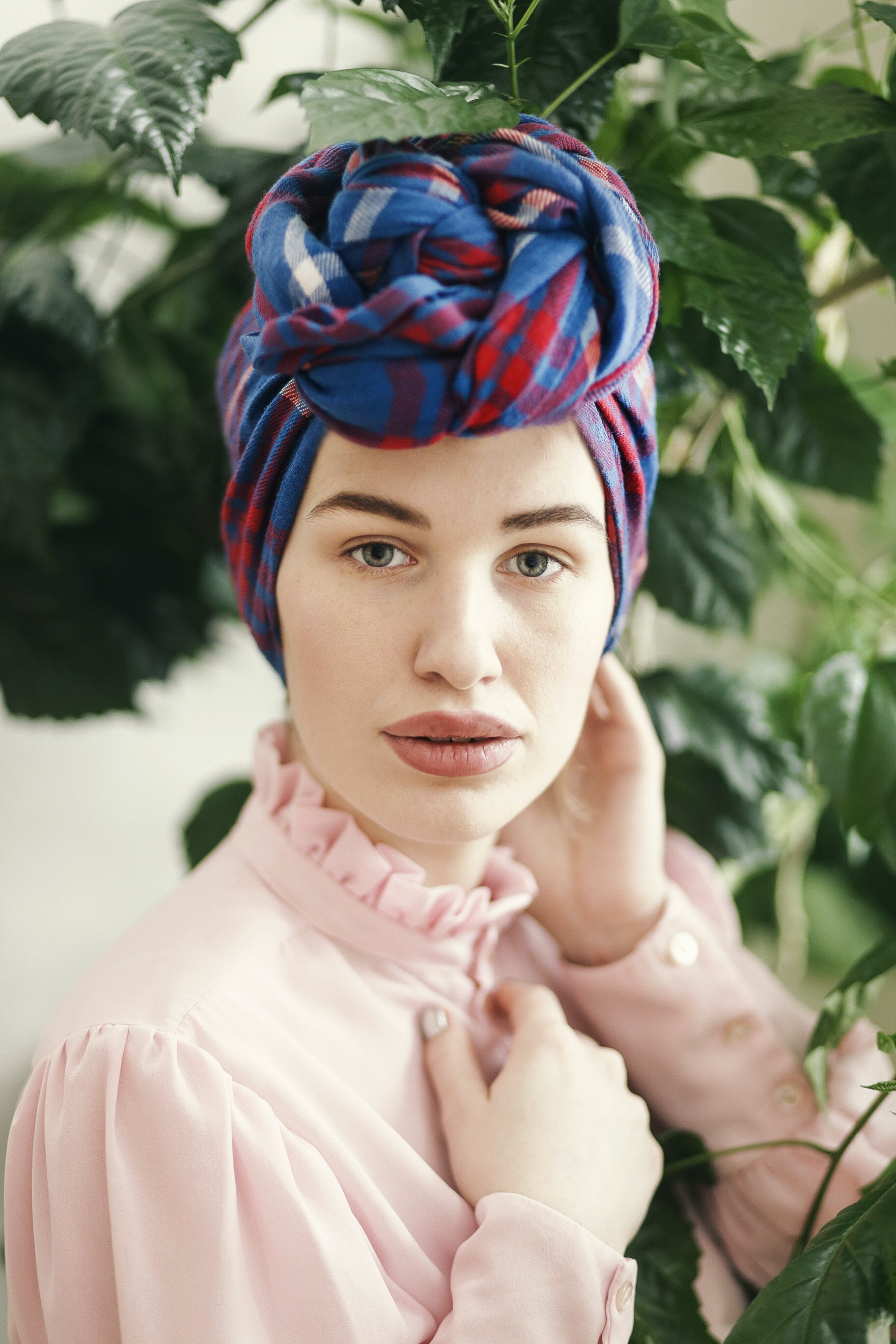Woman in Pink Long-sleeved Top and Blue and Red Headdress