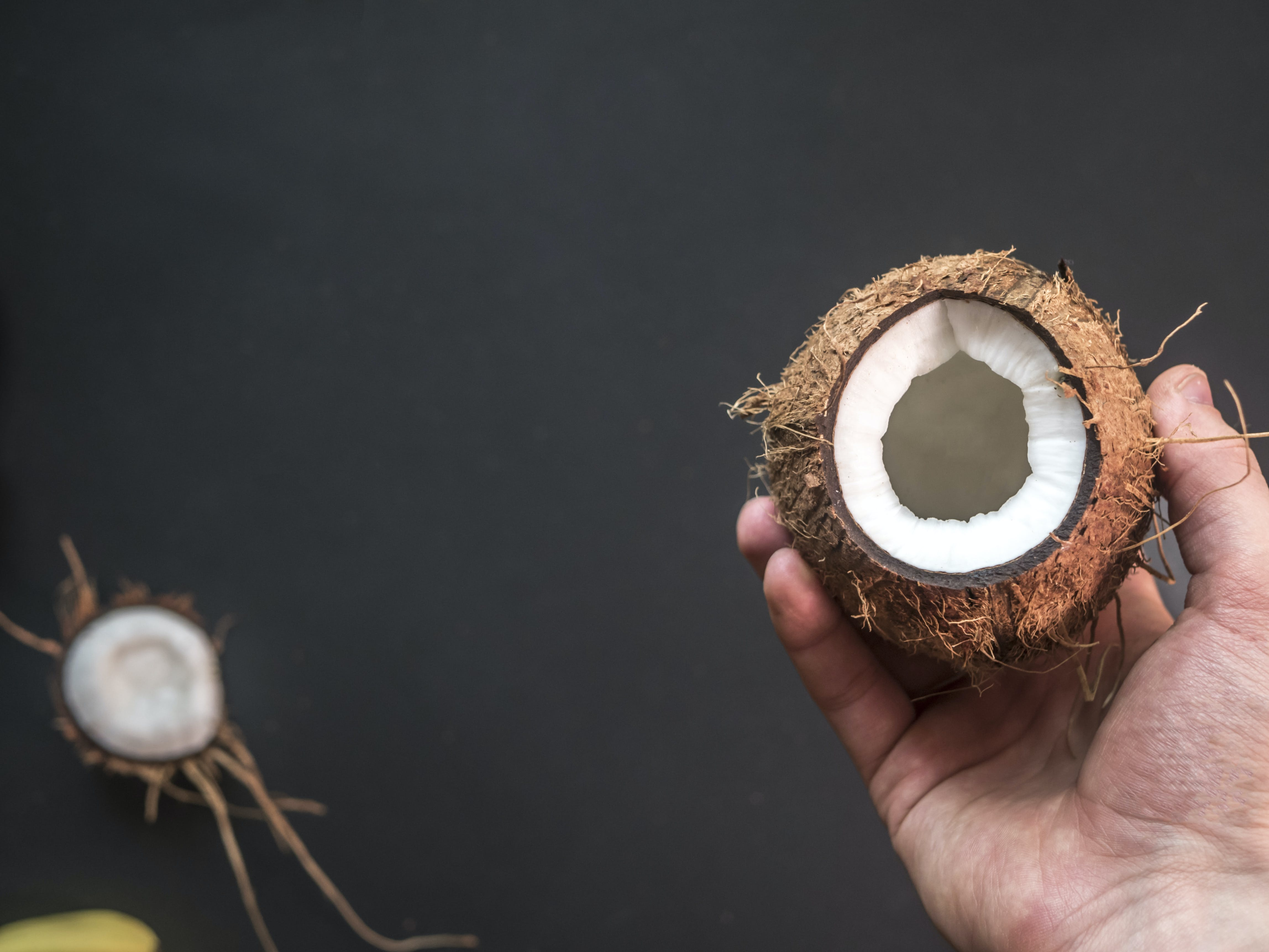 Person Holding Opened Coconut