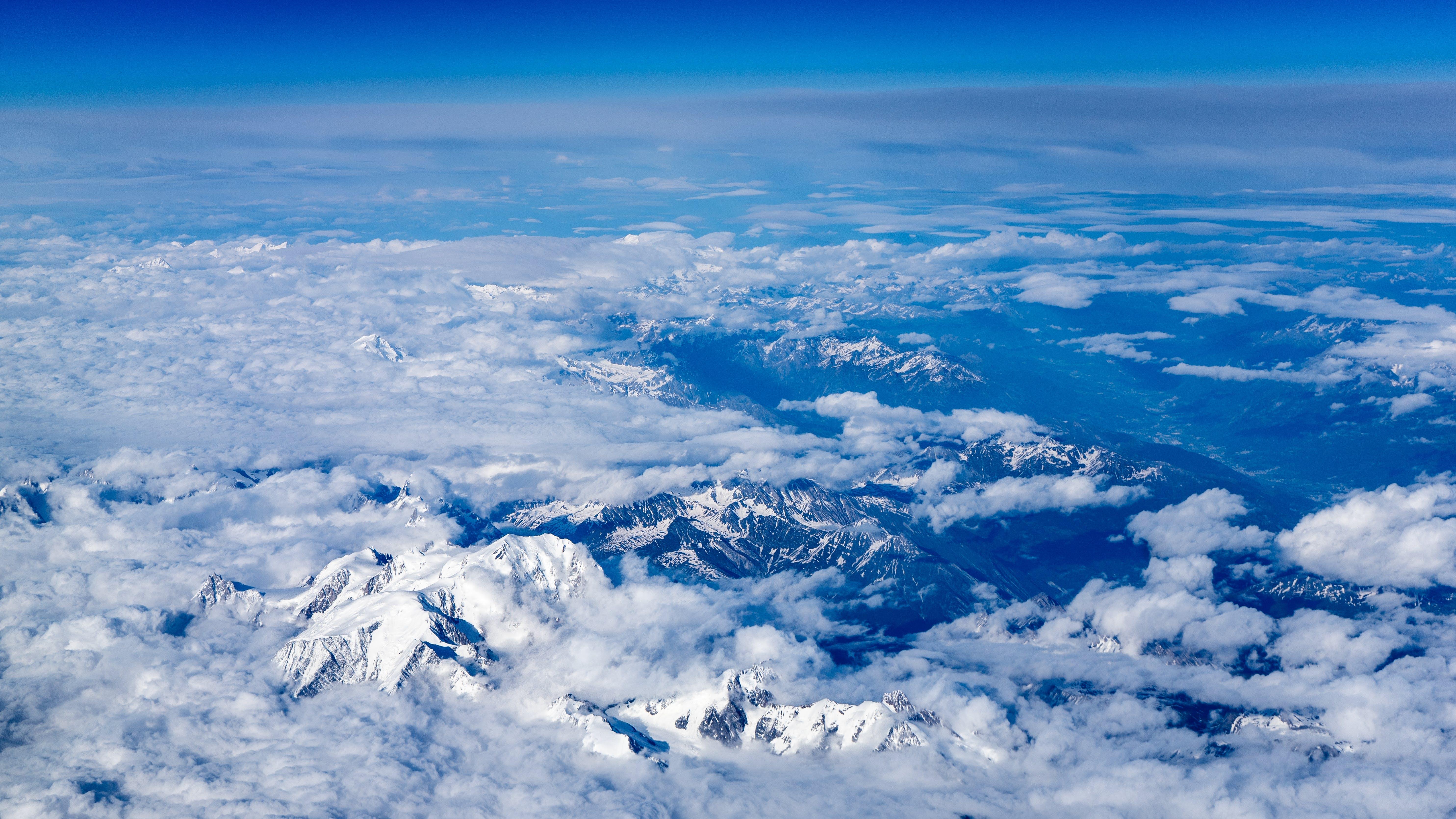 Foto d'estoc gratuïta de alps, cel, cel espectacular, cim