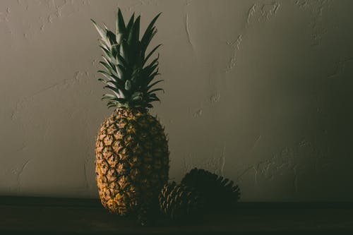 Pineapple Fruit Near Pine Cones