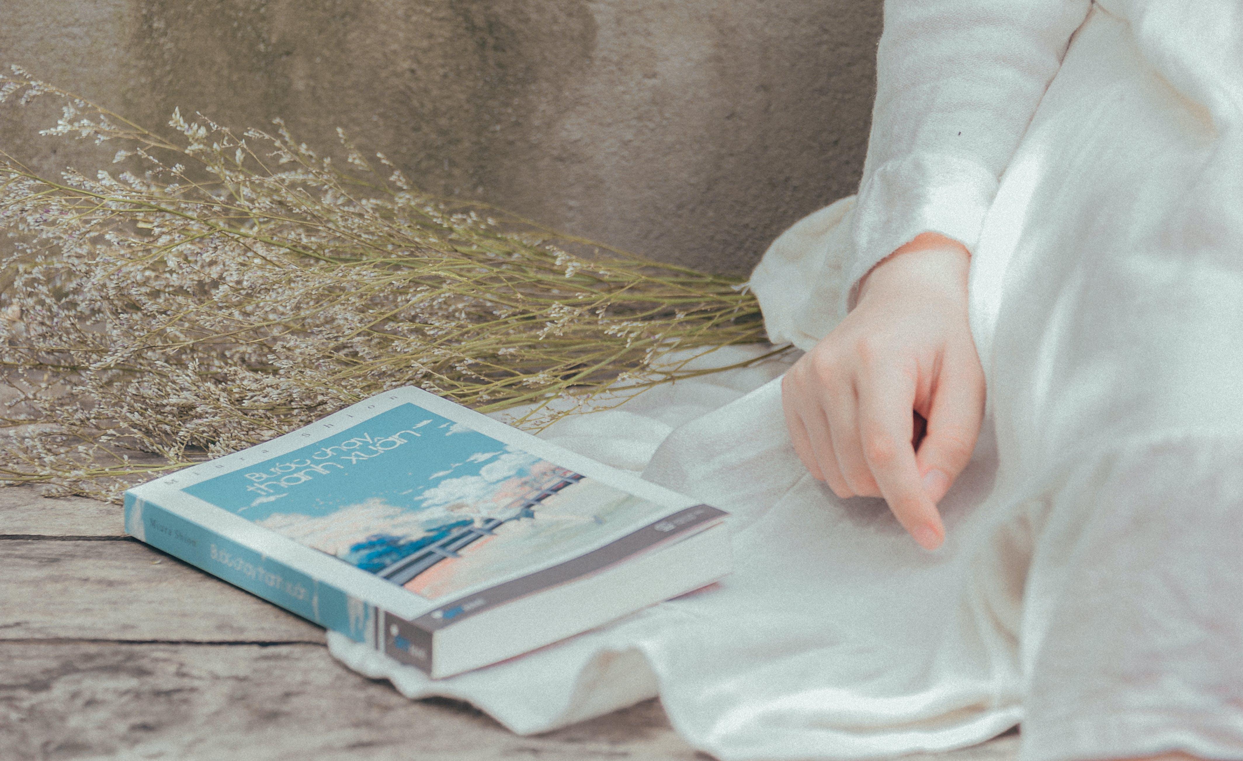 Title Book on White Textile