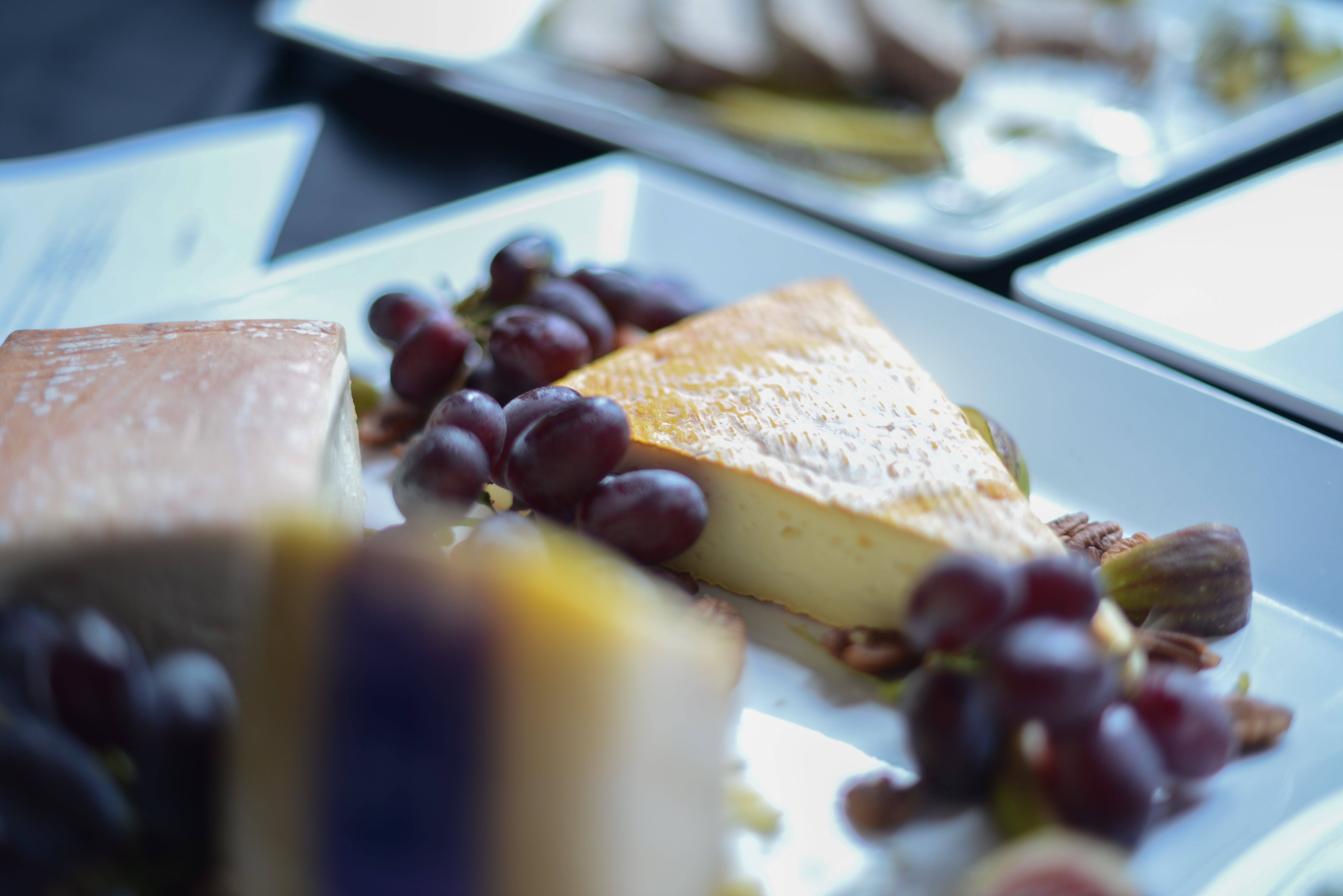 Shallow Focus Photography of Grapes and Sliced Cake