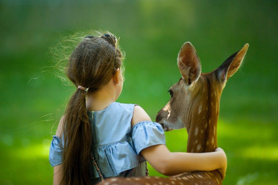 Photo of girl with deer