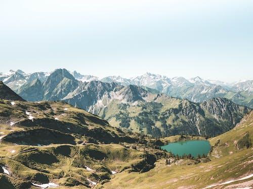Безкоштовне стокове фото на тему «безтурботний, вершина гори, високий, вода»