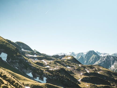 Foto stok gratis cahaya matahari, langit biru, lansekap, pegunungan