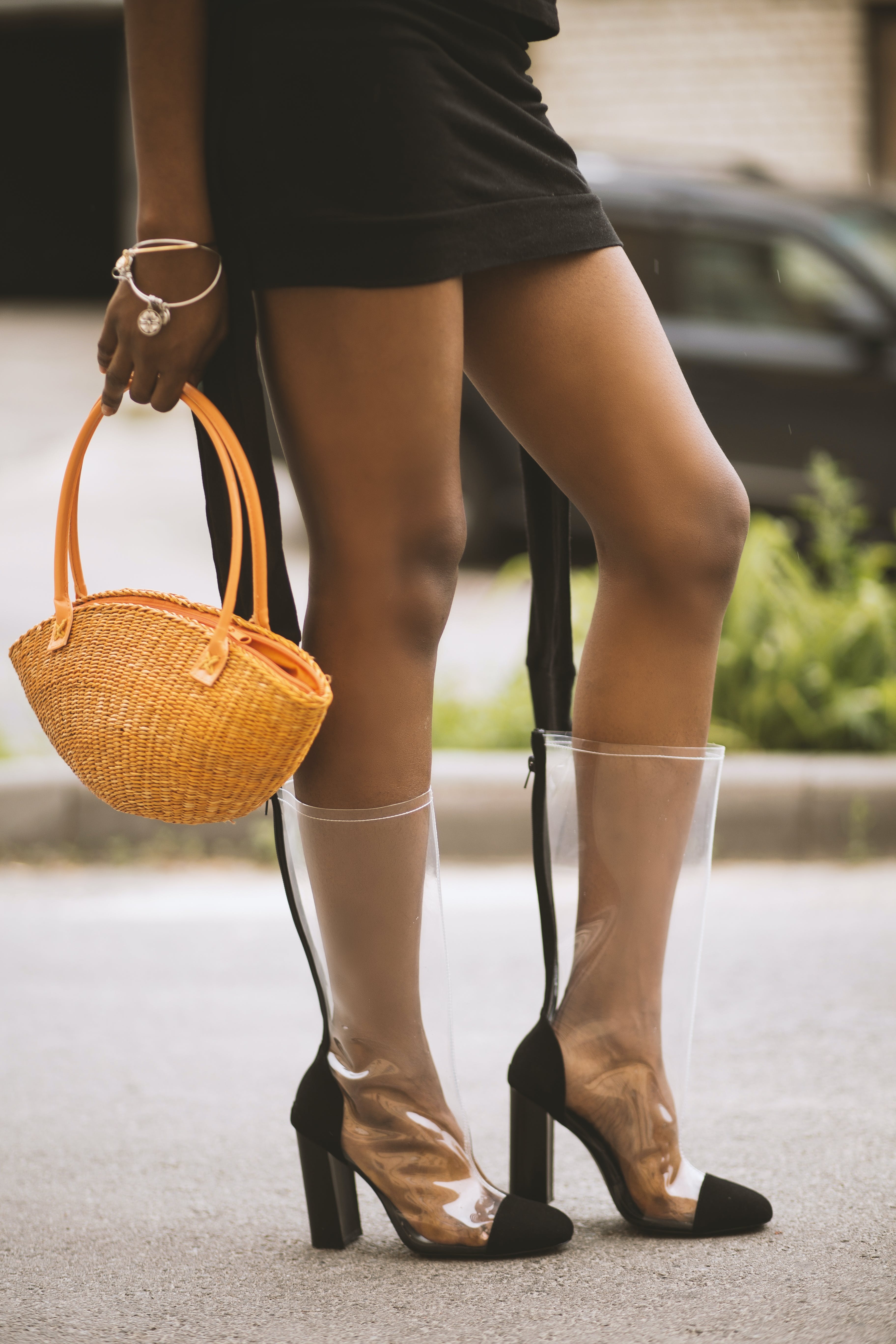 Woman Wearing Clear-and-black Chunky Heeled Boots