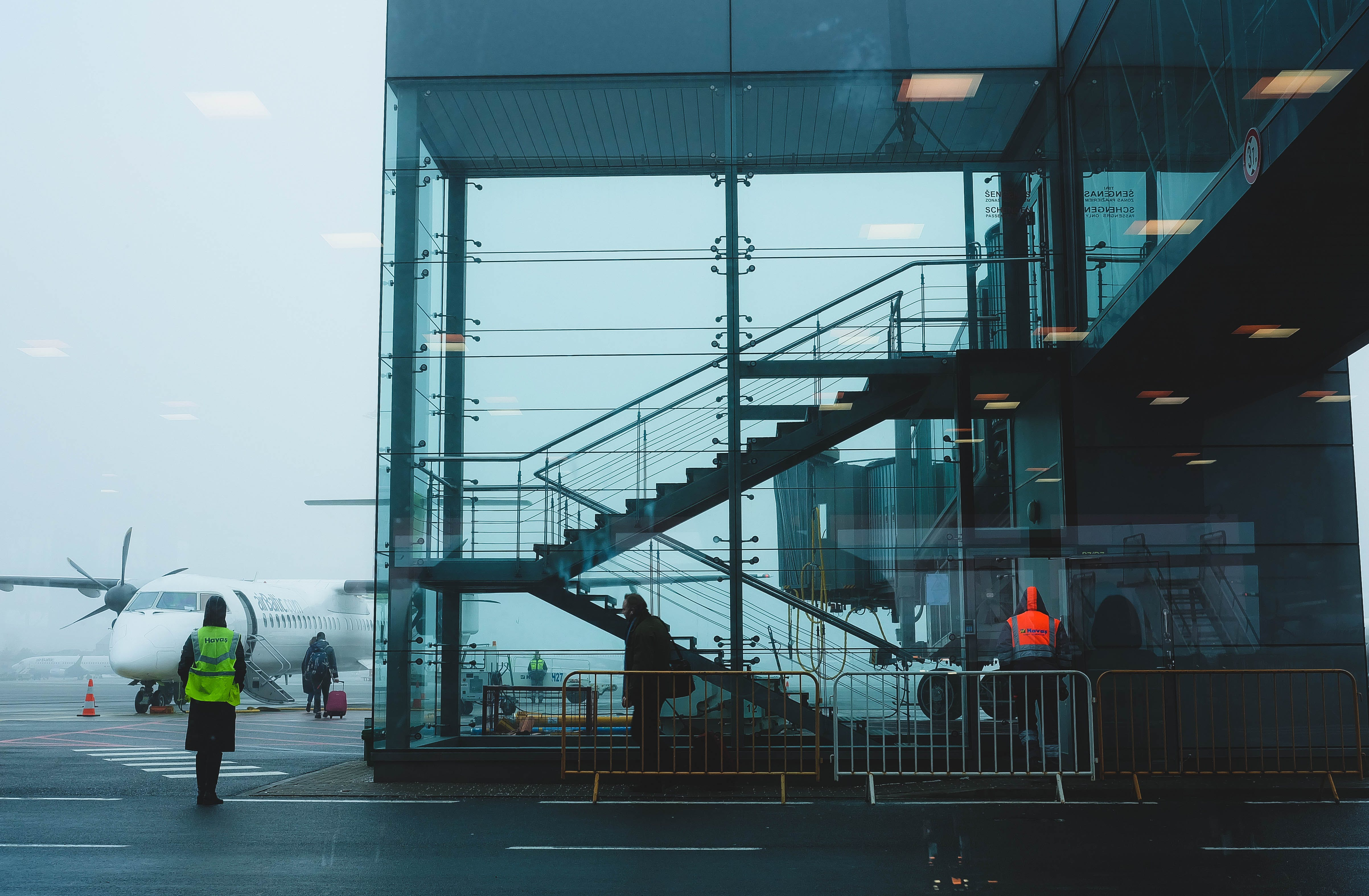 Photo of Glass Building Near Airplane