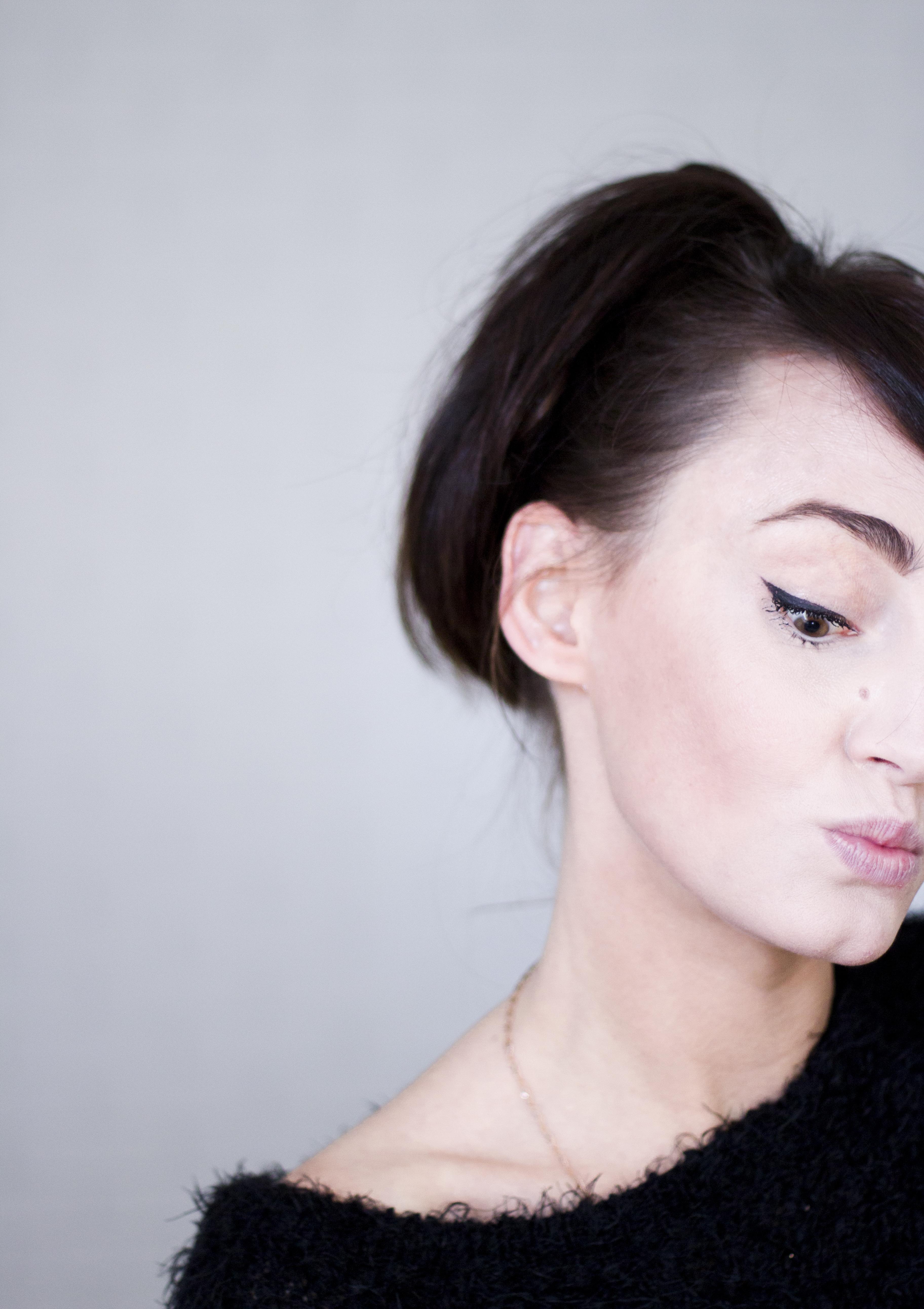 Woman in Black Crew-neck Fleece Top