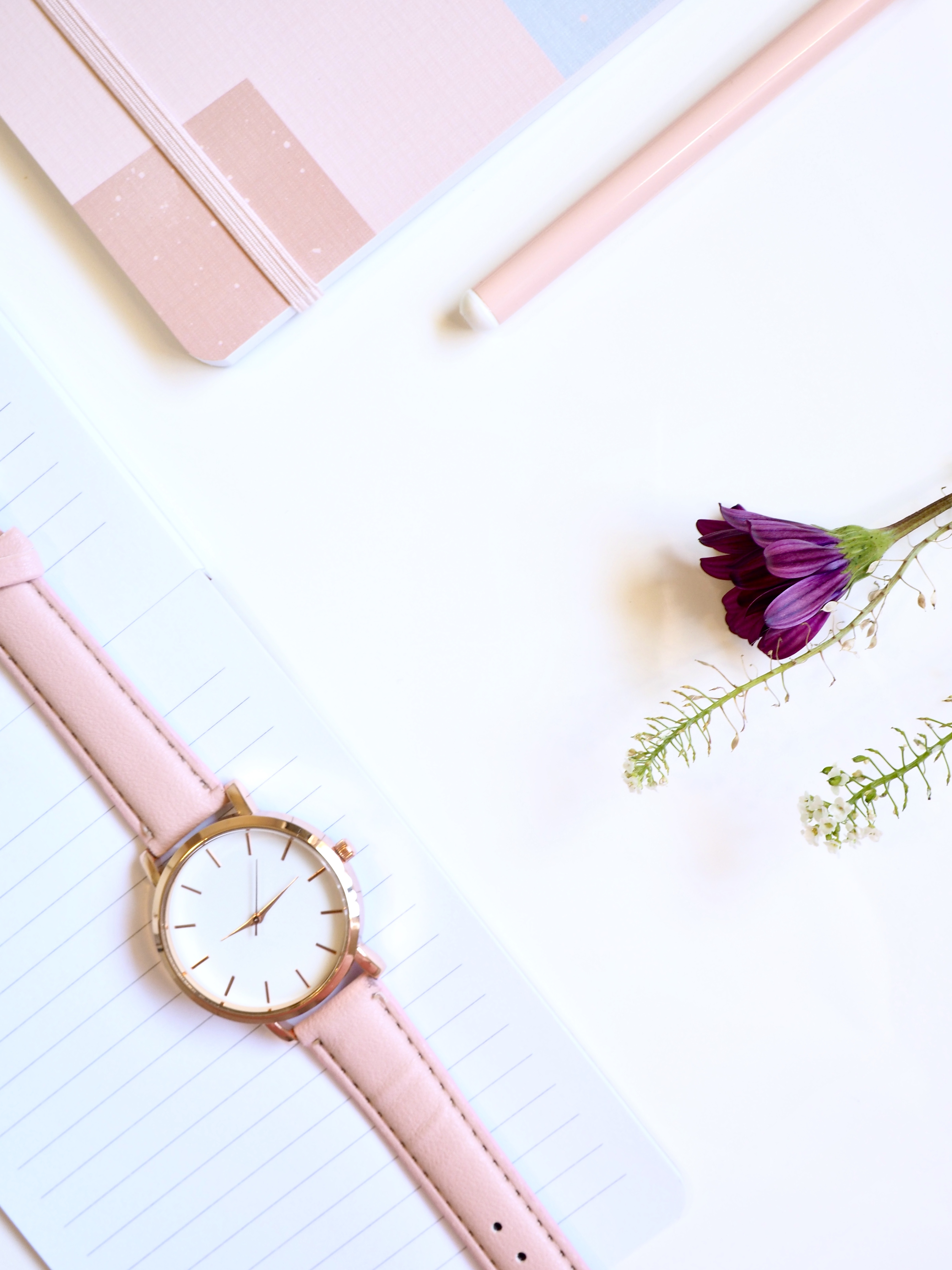 Round Gold-colored Analog Watch at 2:46 on Top of White Paper