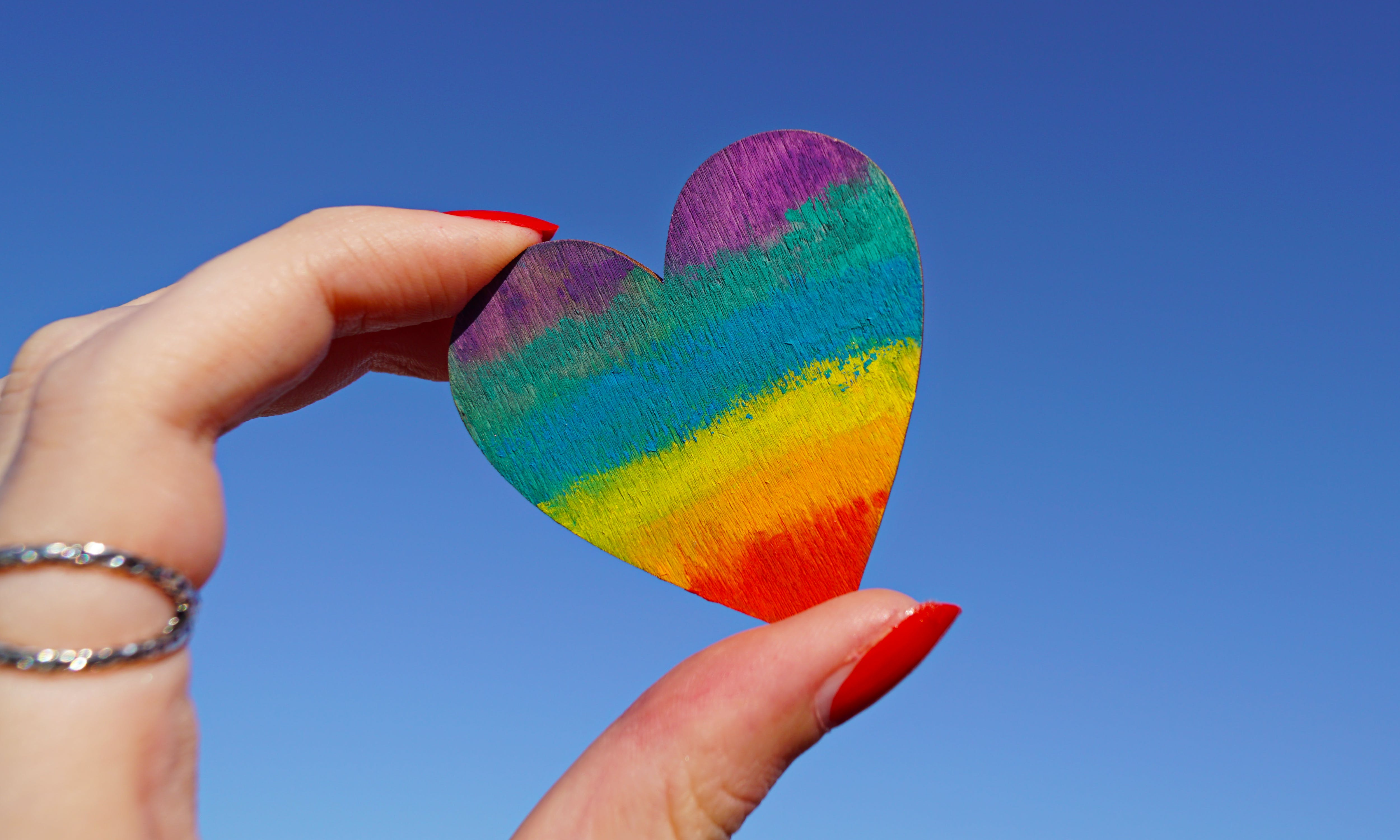 Person Holding Multicolored Heart Decor