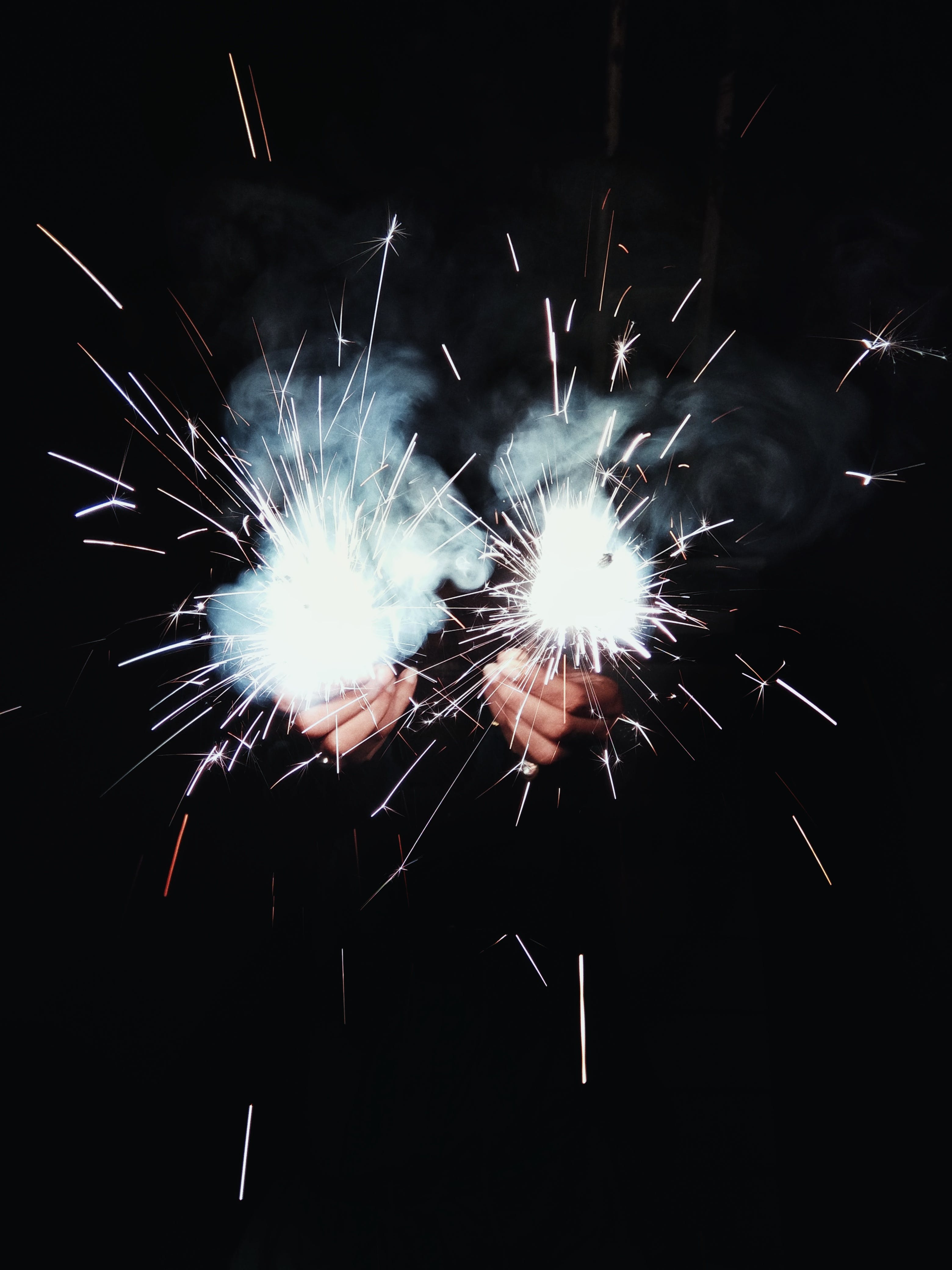 Photo of Person Holding Sparklers