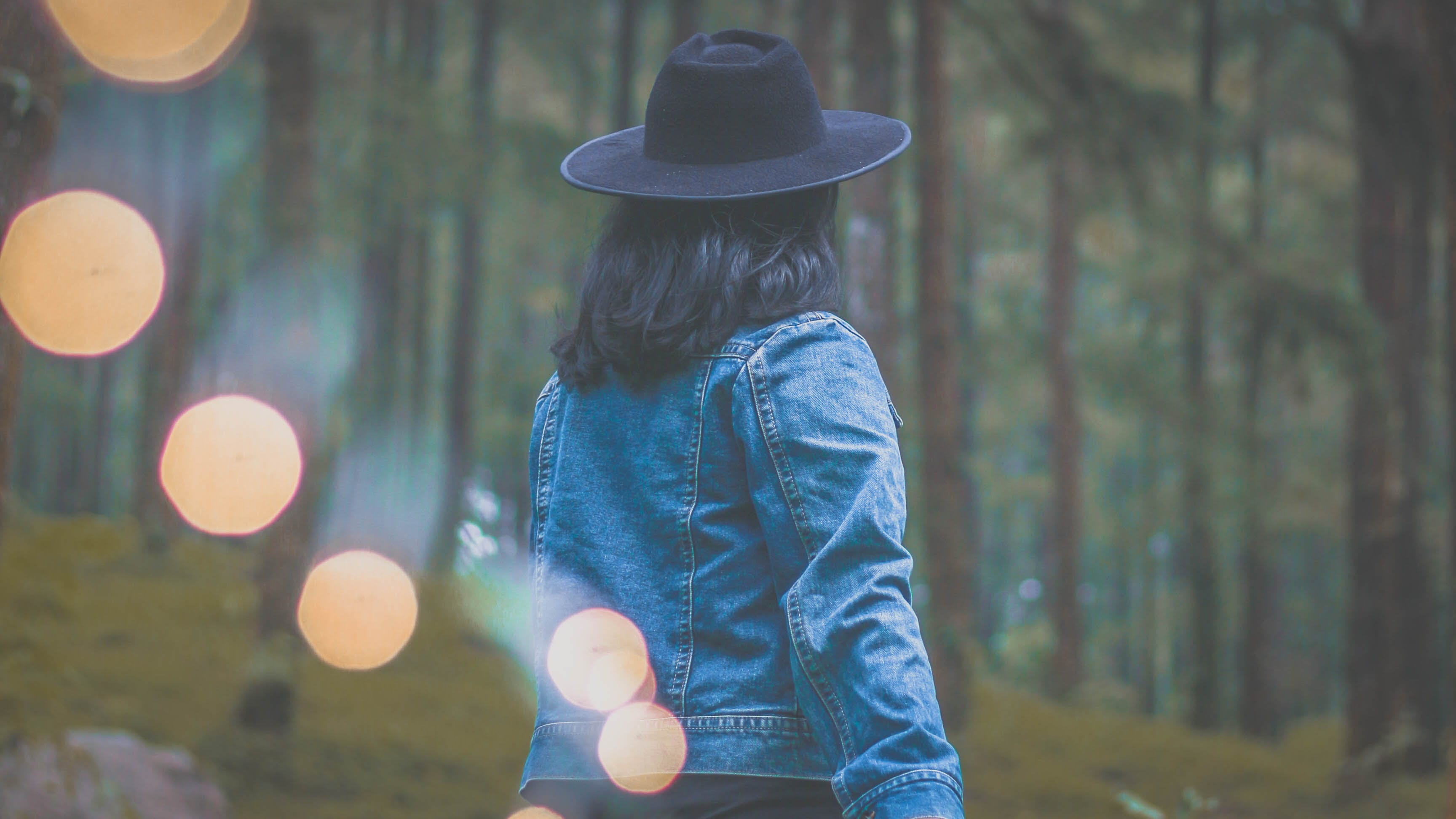 Photo of Woman Wearing Denim Jacket and Black Hat