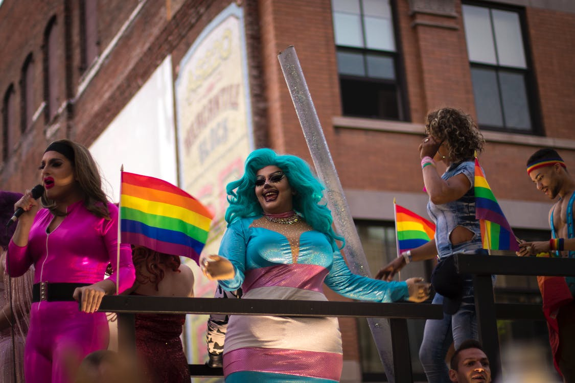 Photo of Person Holding Lgbt Flag