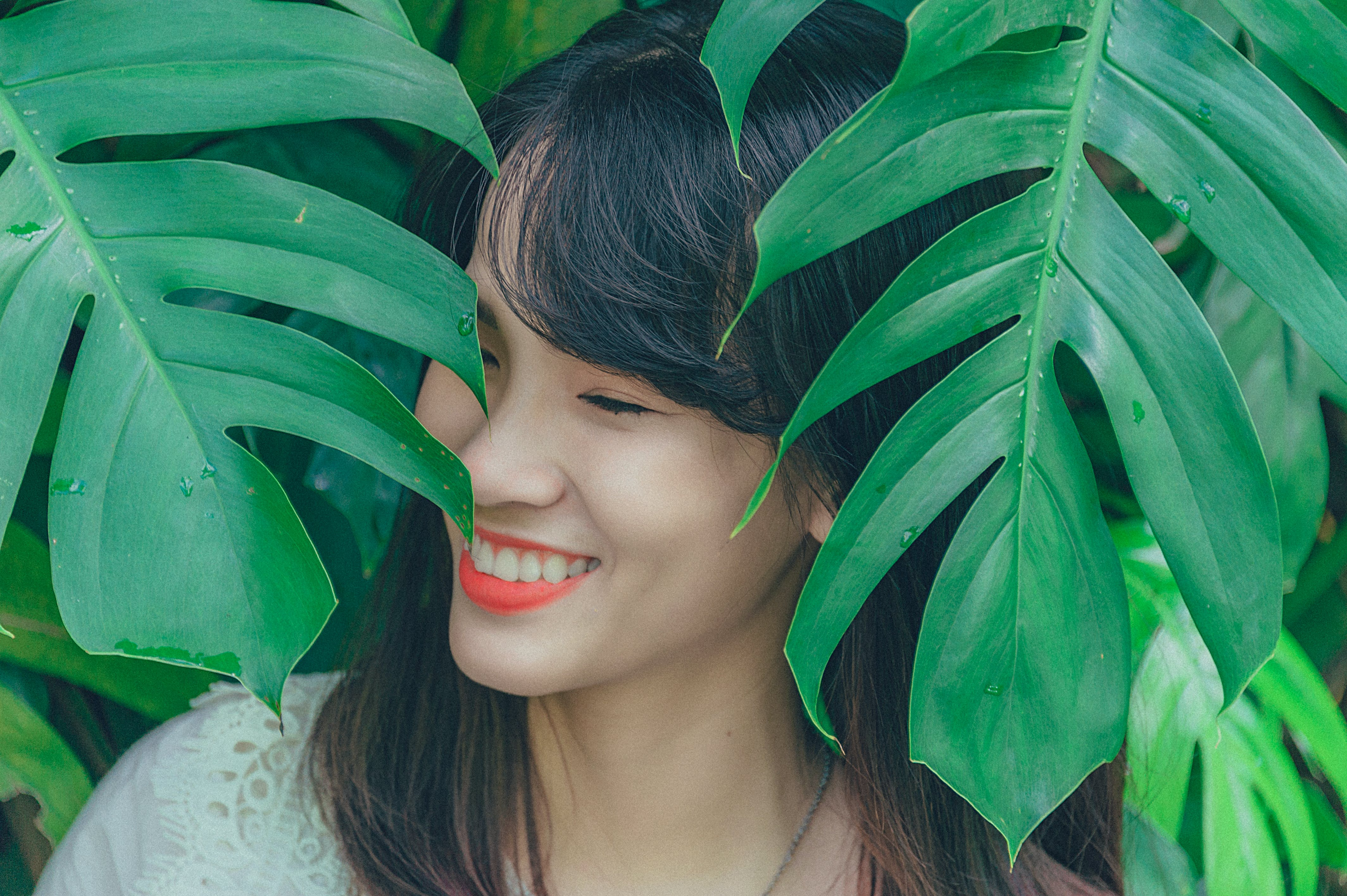Close-Up Photography of Girl Near Leaves