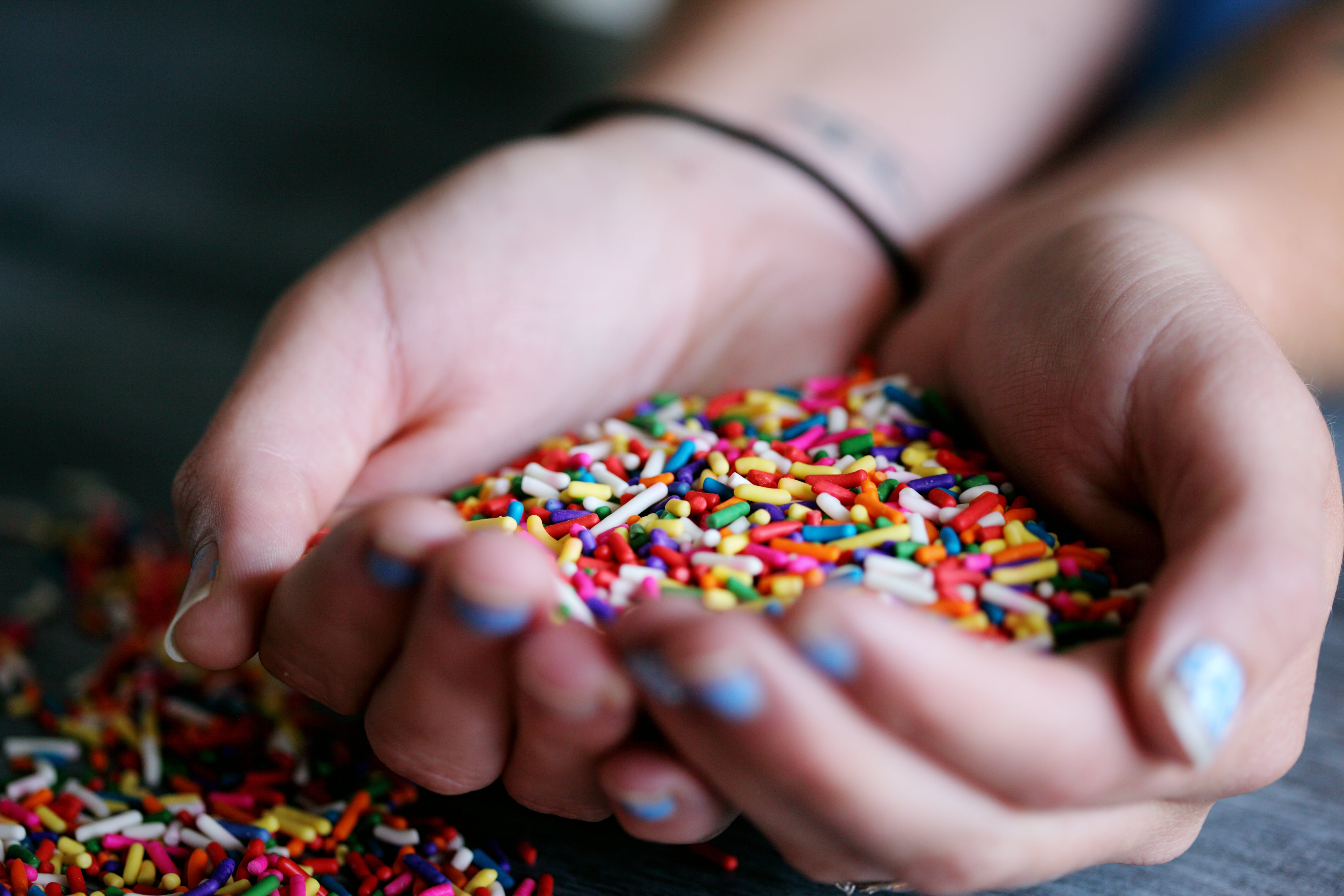 Person Holding Full of Sprinkles