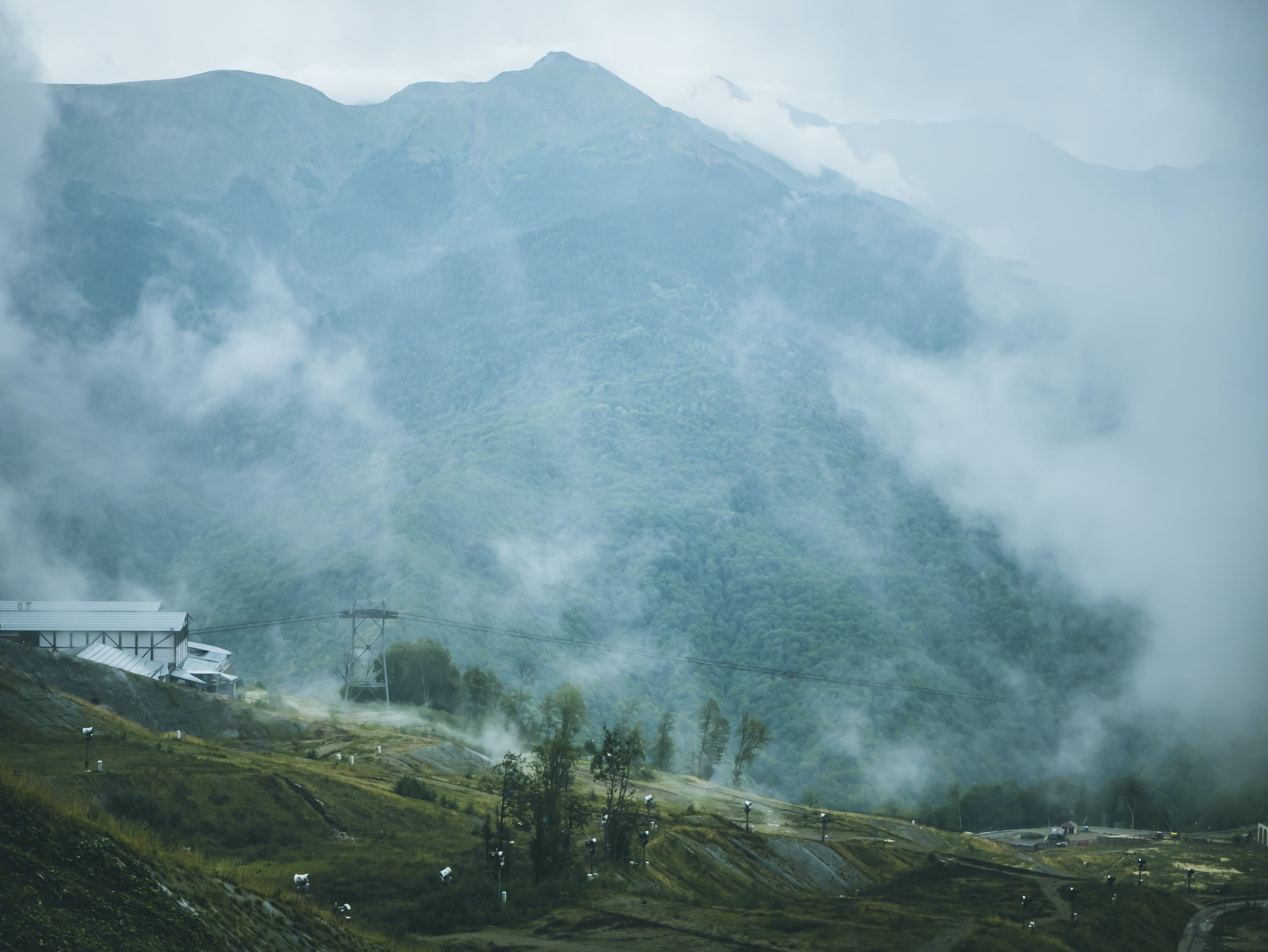 Green and Gray Foggy Mountain