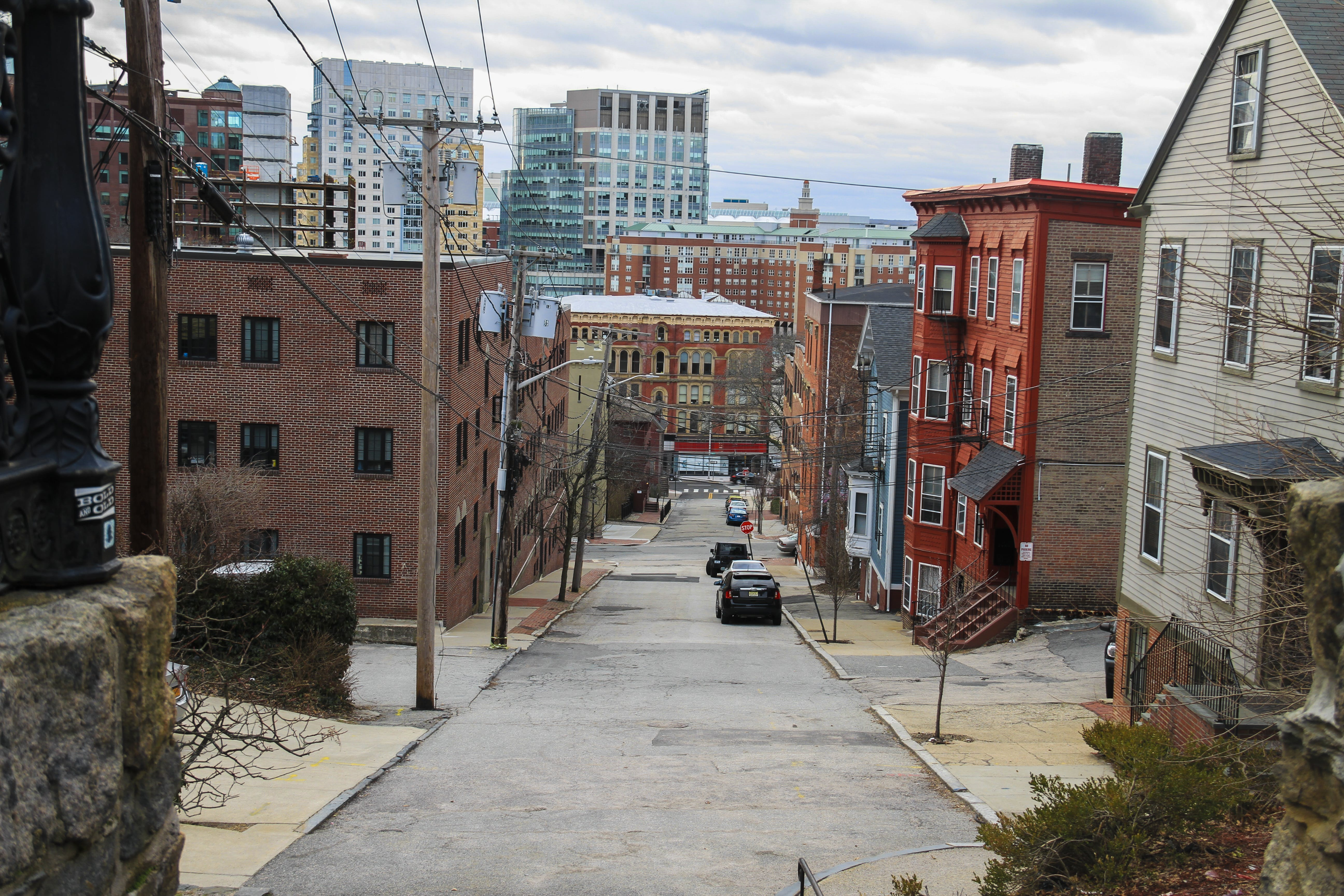 Free stock photo of alleyway, apartment buildings, apartments, cars on street