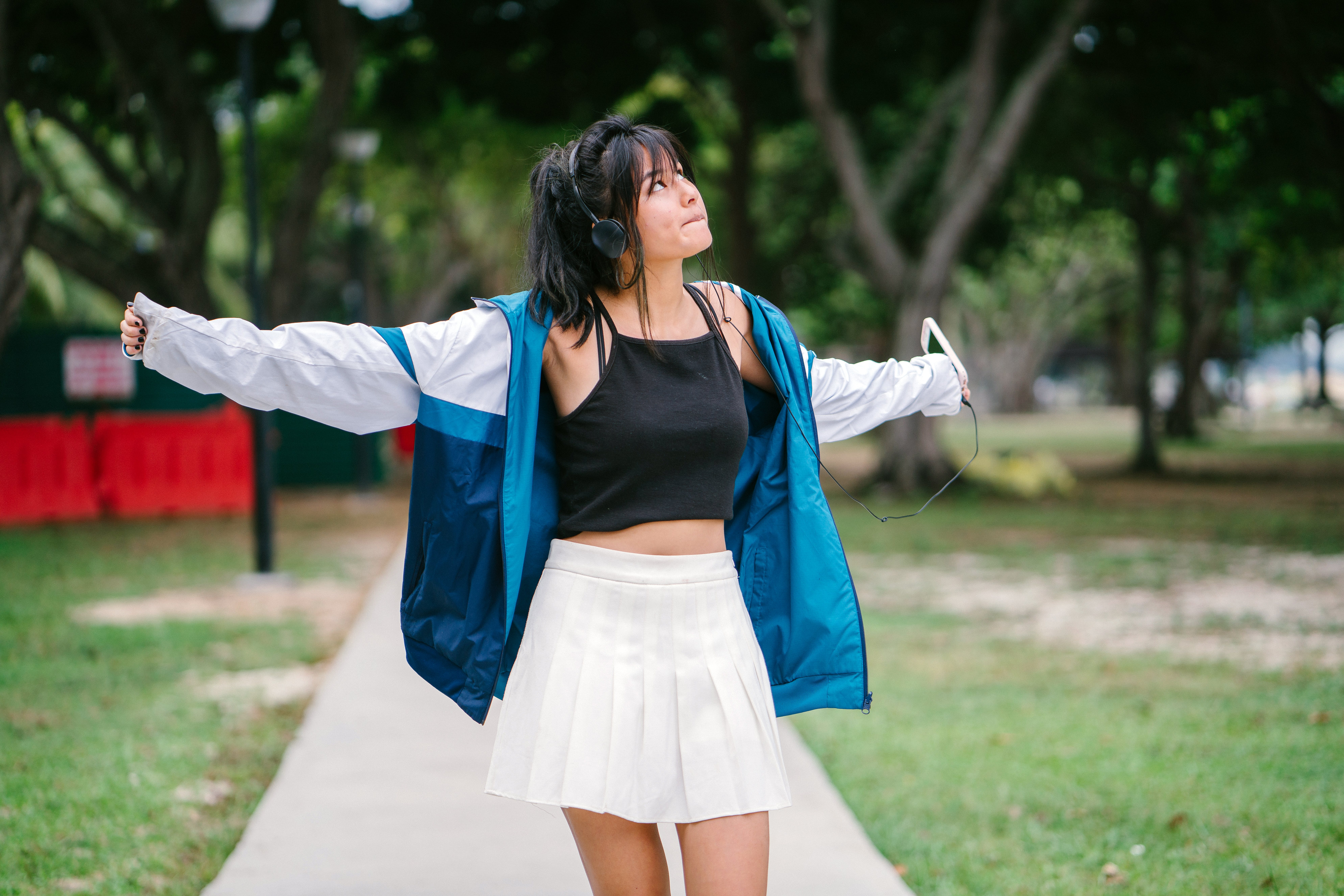 Woman Wearing Jacket, Crop Top and Mini Skirt