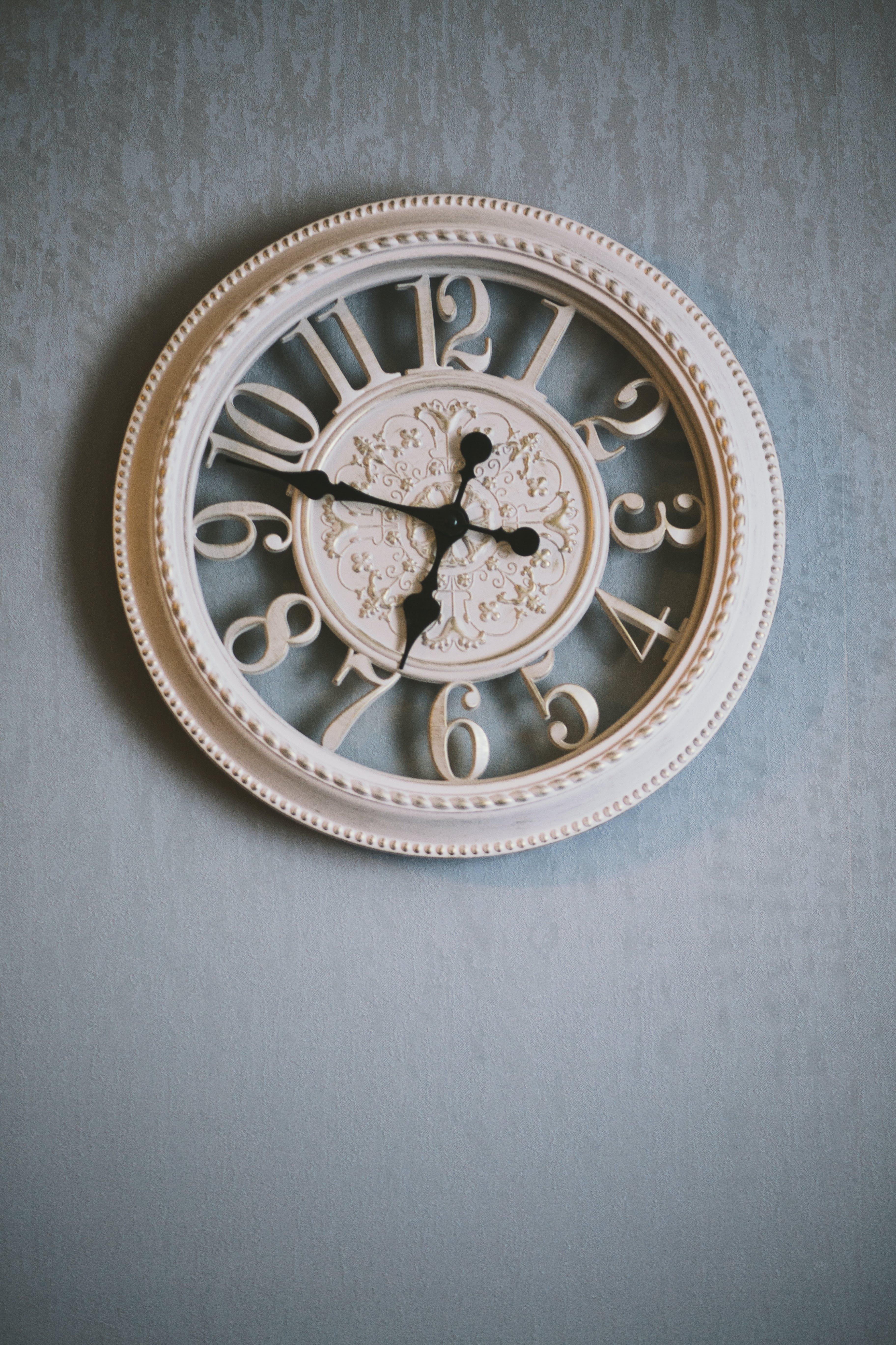 Round White Analog Clock Showing Time