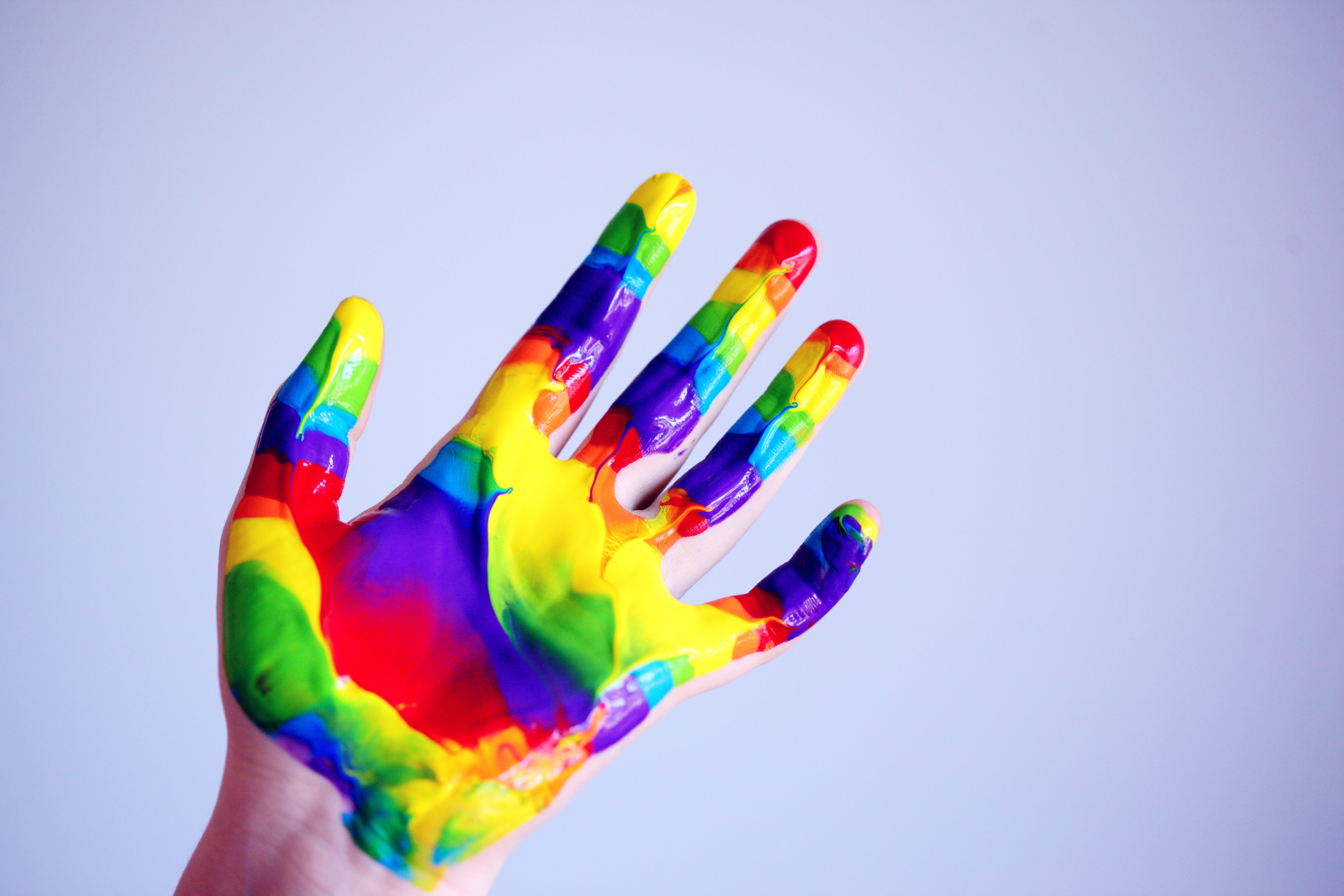Person's Hand With Paints