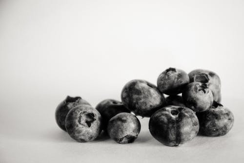 Grayscale Photography of Blueberries
