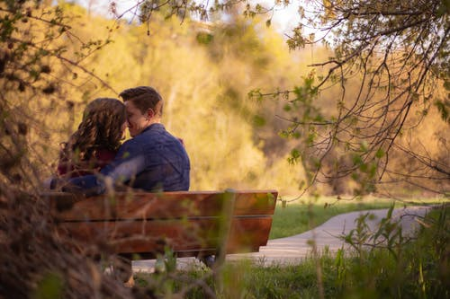 Photography of Couple Sitting on Bench