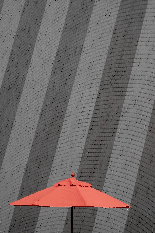 Closeup Photo of Red Patio Umbrella