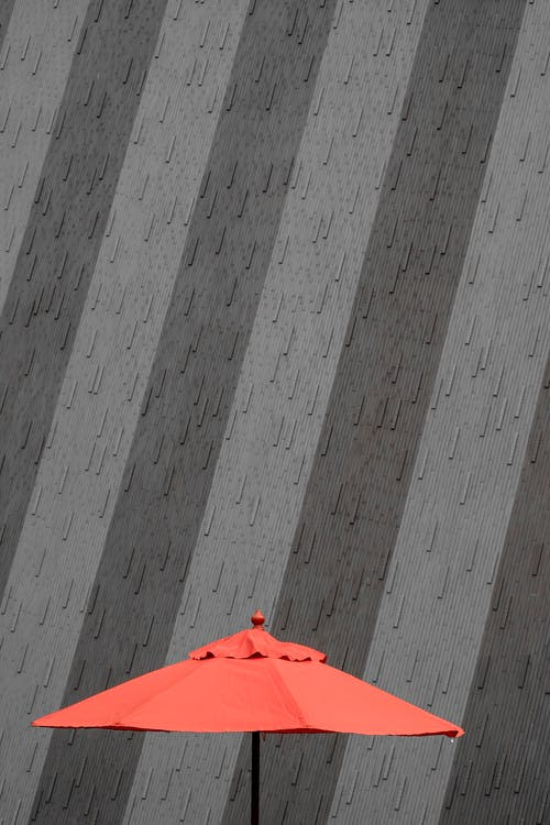 Closeup Photo of Red Patio Umbrella
