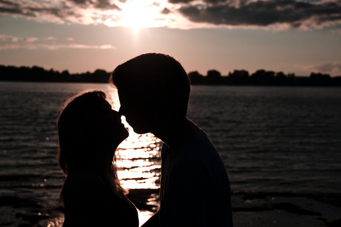 Silhouette Photo of Man and Woman Kissing