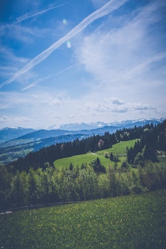 Landscape Photography of Green Grass Field Mountain