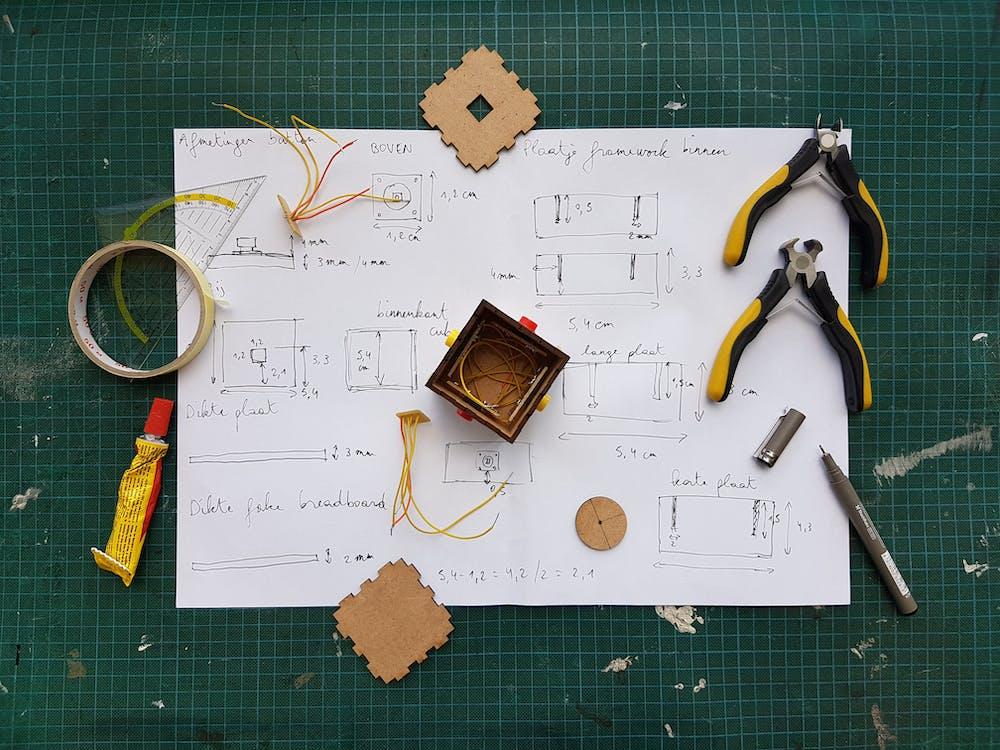 White Diagram Paper Under Pliers