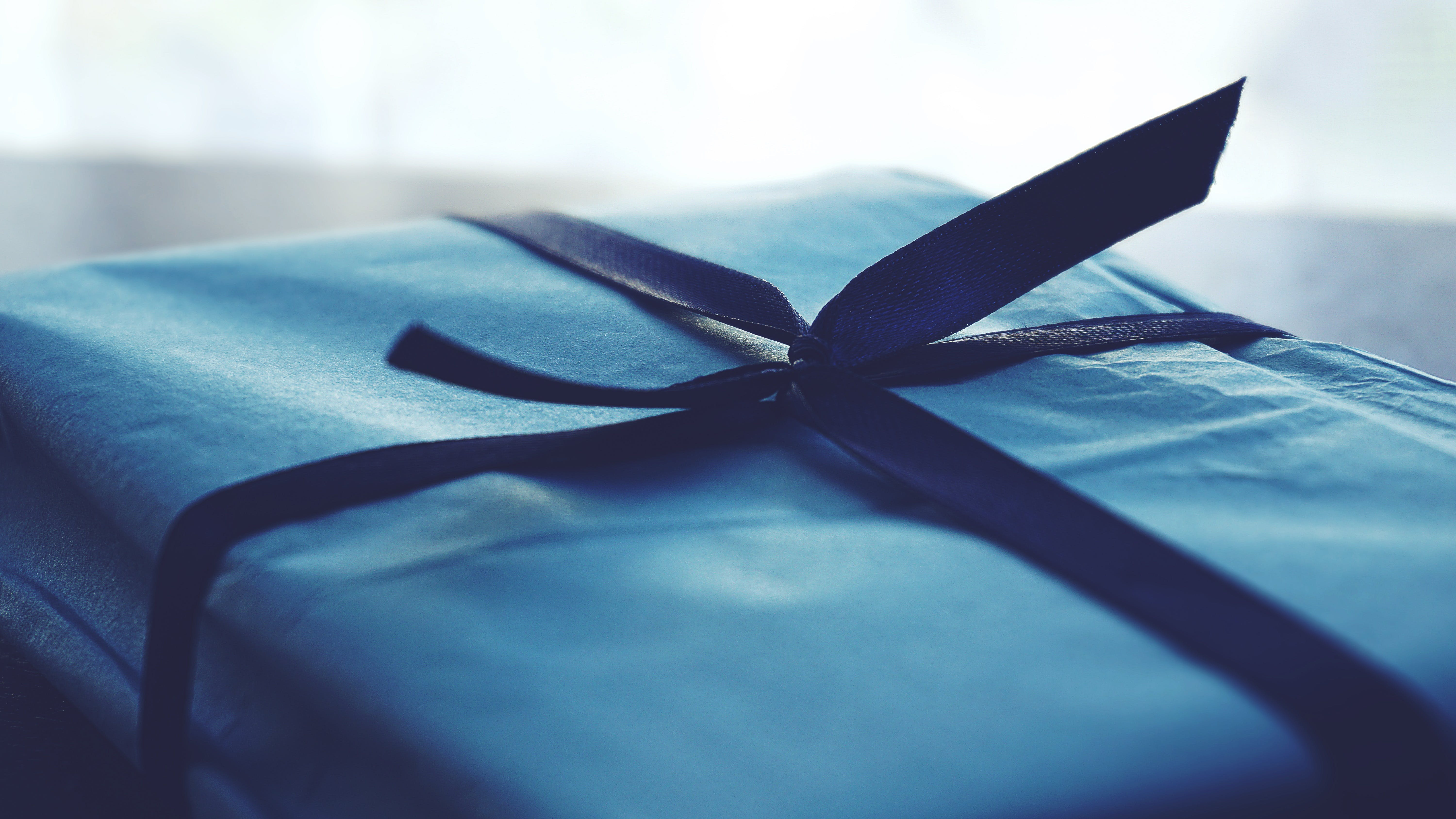 Close-up Photo of Tied Blue Box