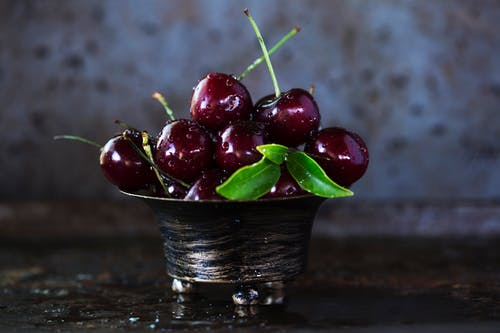 Red Cherries on Stainless Steel Bowl