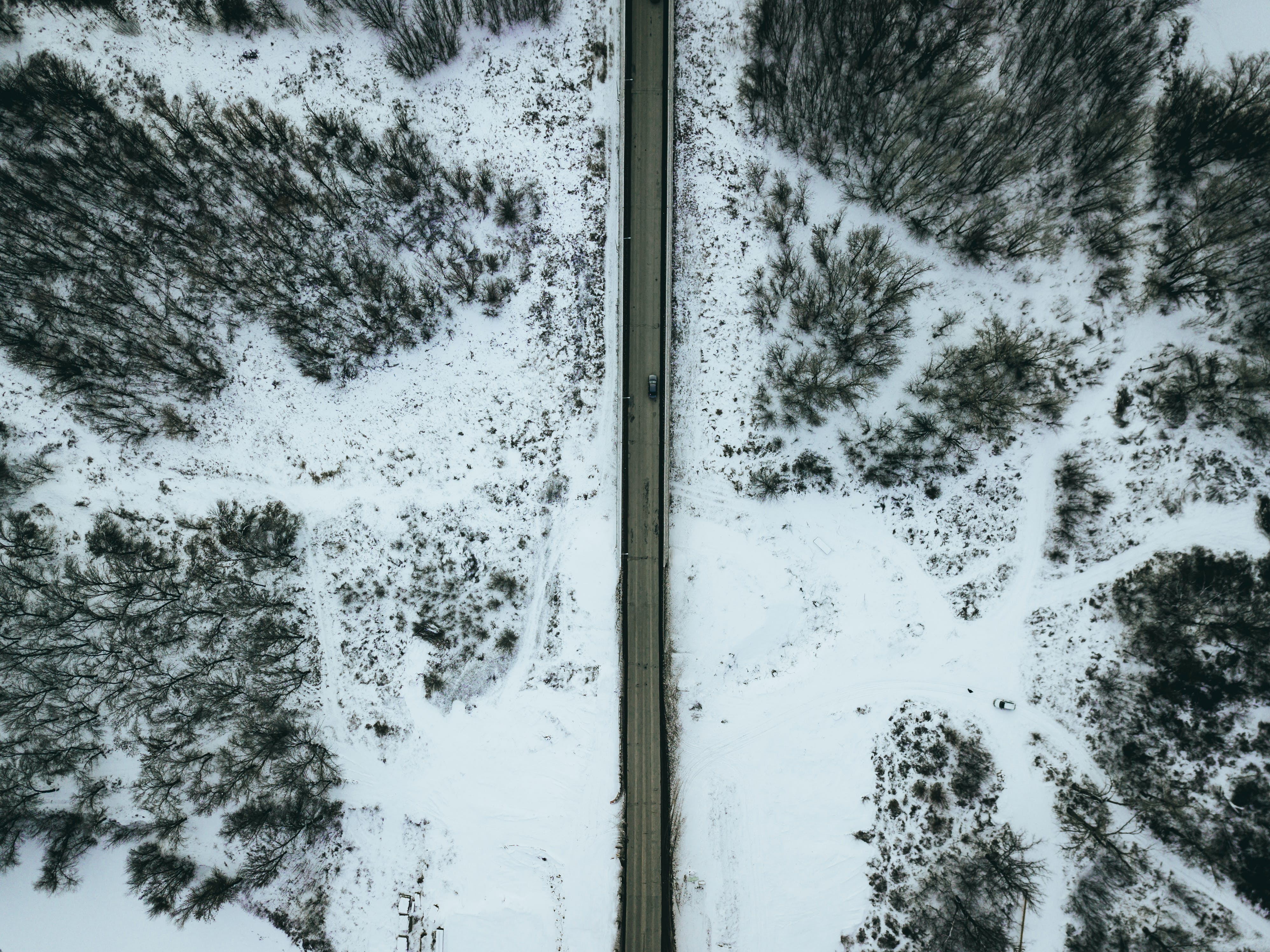 Aerial Photo of Gray Concrete Road during Winter