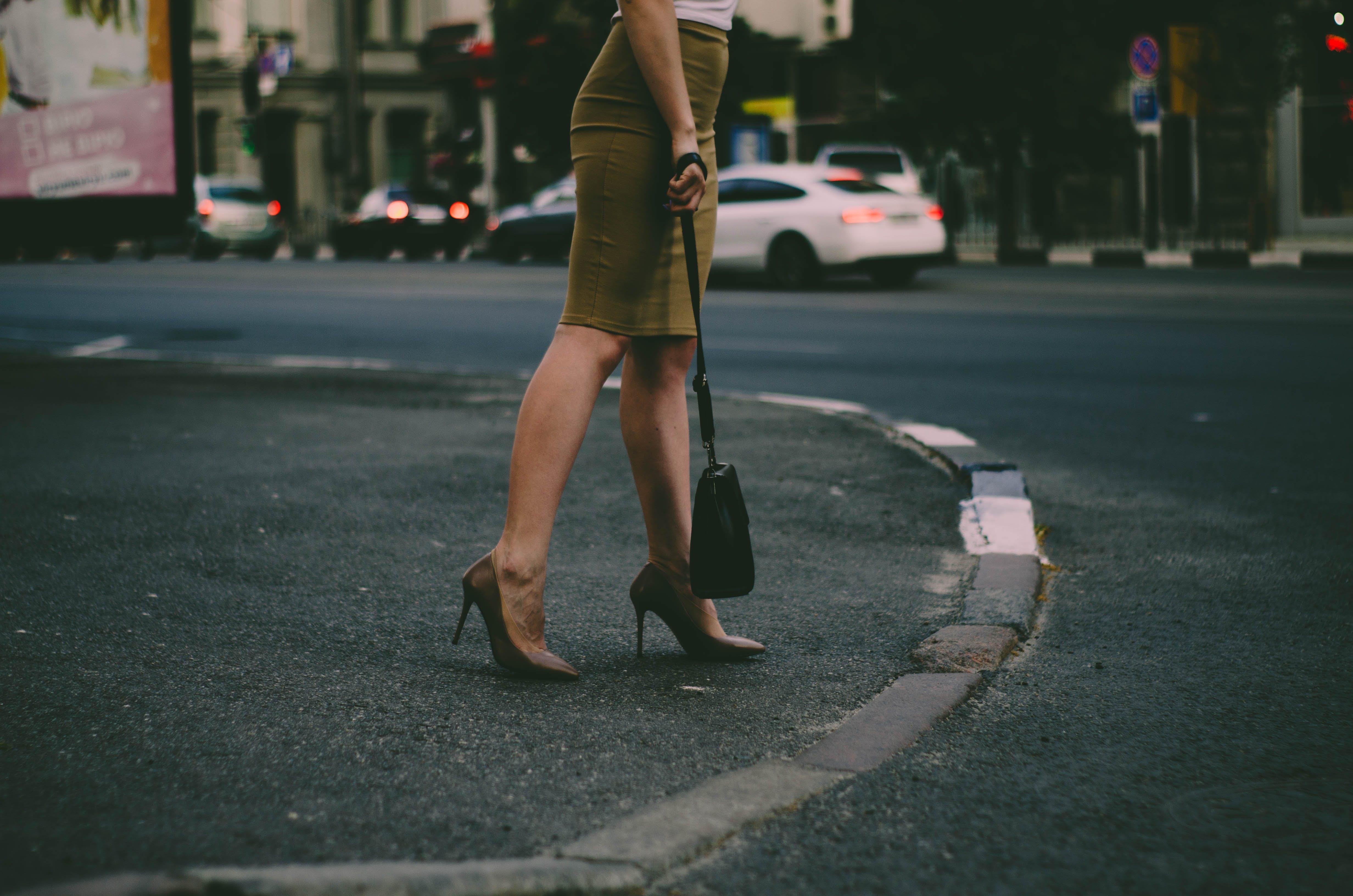 Woman's Holding Black Sling Bag