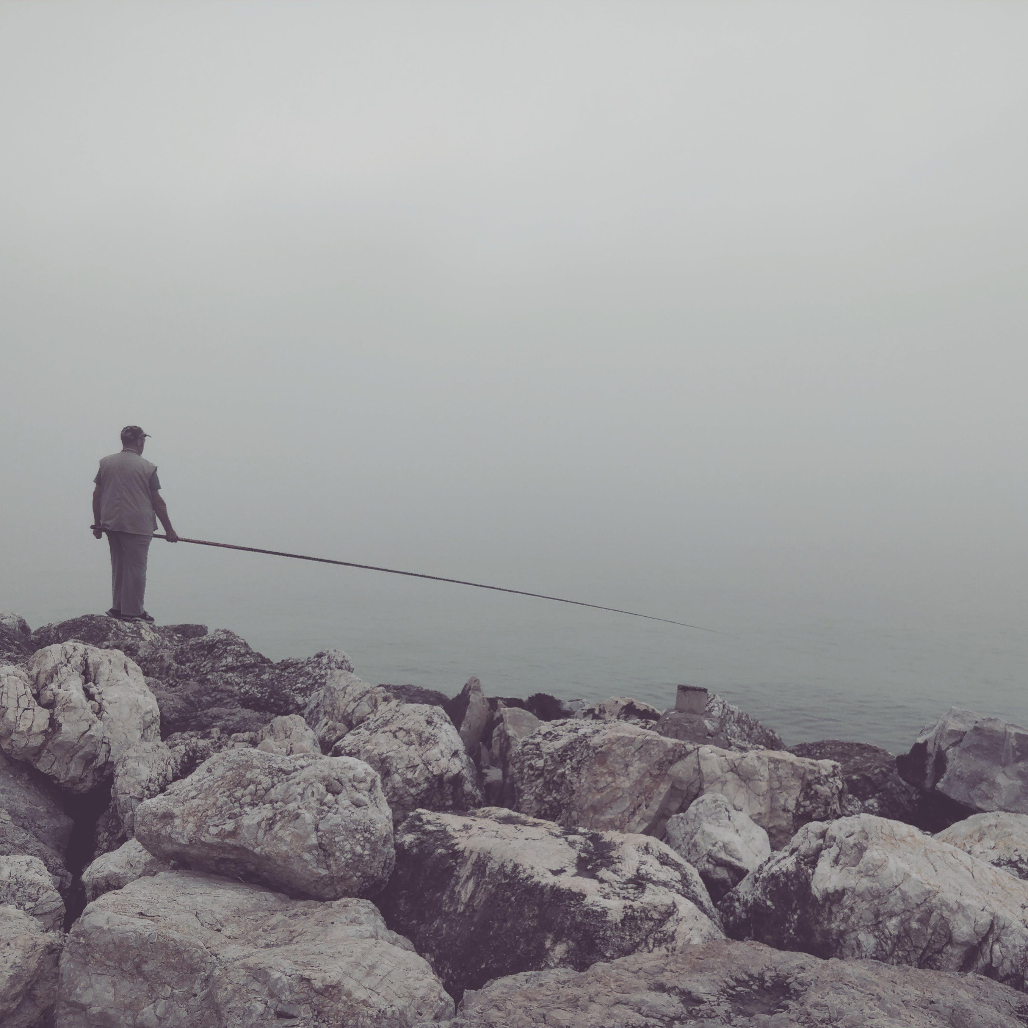 Free stock photo of fishing, fog, foggy, rocks