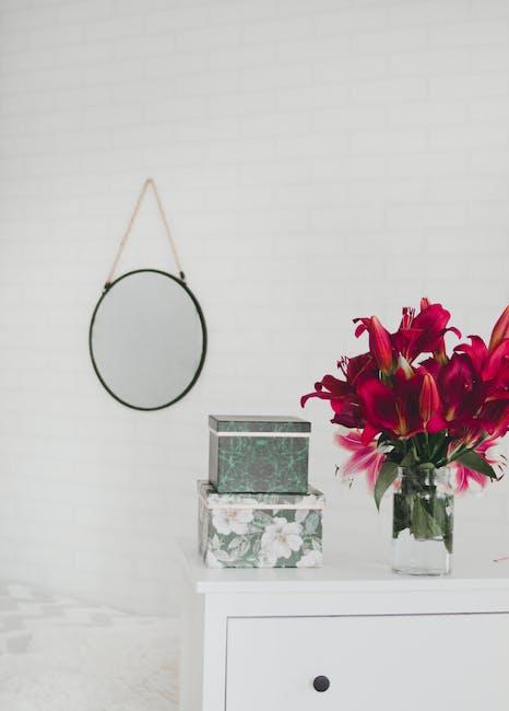 Red Flower Centerpiece on White Wooden Drawer Dresser