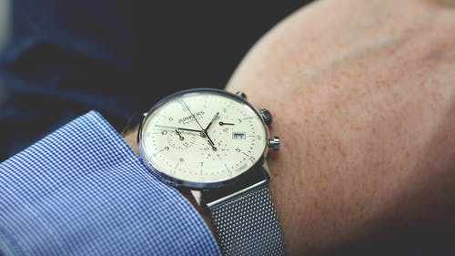 Person Wearing Silver-colored Analog Watch