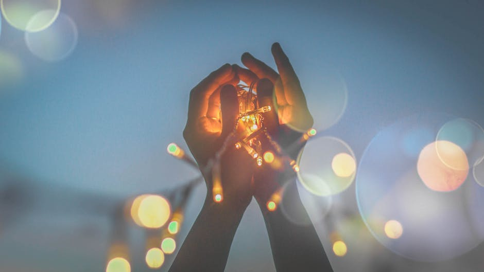Person's Hand With Light Bokeh